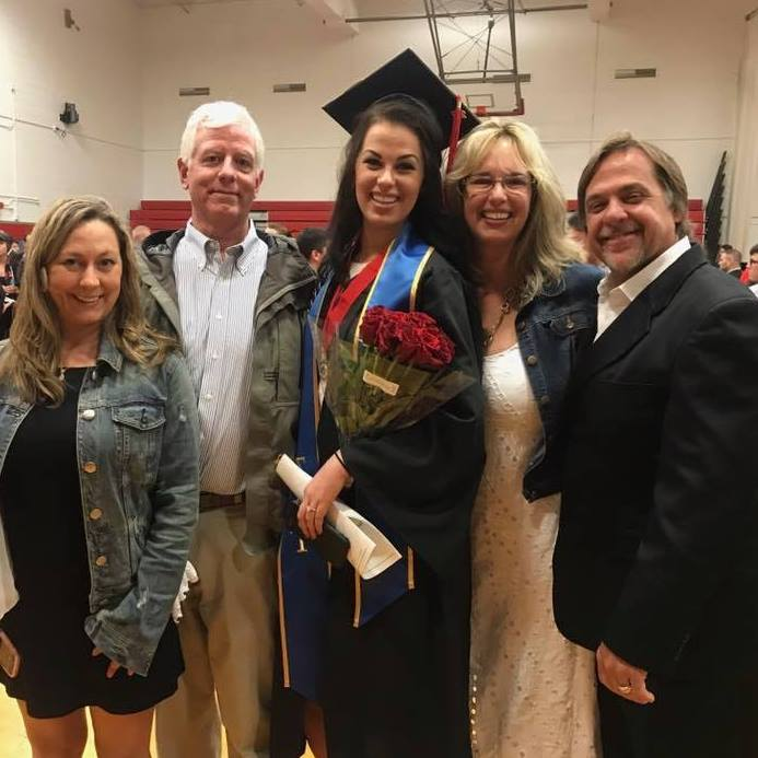Michaela with her family at graduation