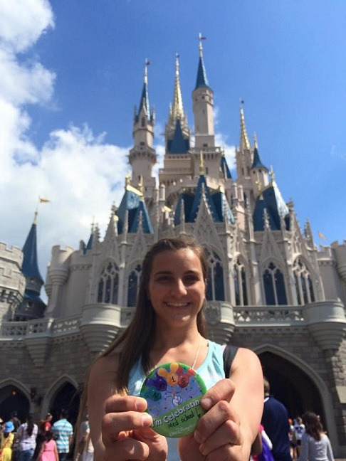Marissa celebrating her acceptance to GWU at DIsney World.