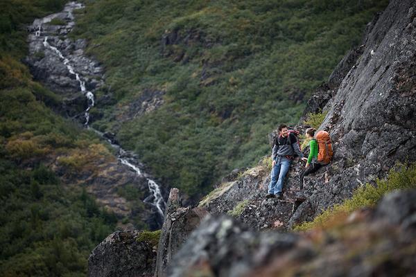 Hikers near a waterfall in Narsarsuaq.jpg
