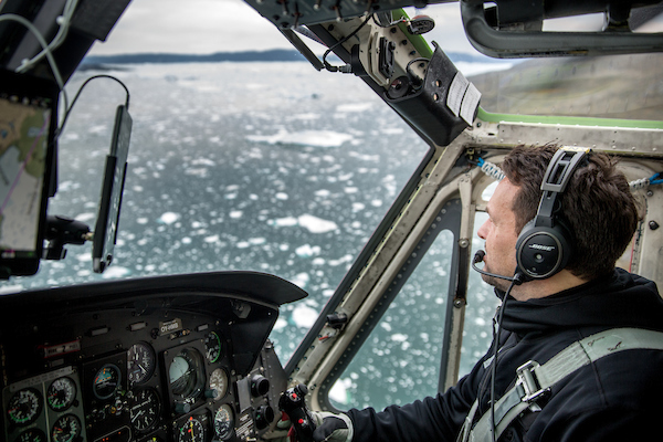 An Air Greenland Bell 212 helicopter pilot over the Ilulissat ice fjord in Greenland.jpg