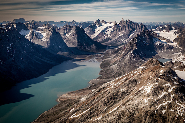 A view over the fjord leading towards the famous Triplets peaks and the glacier near Tasiilaq Mountain Hut in East Greenland.jpg