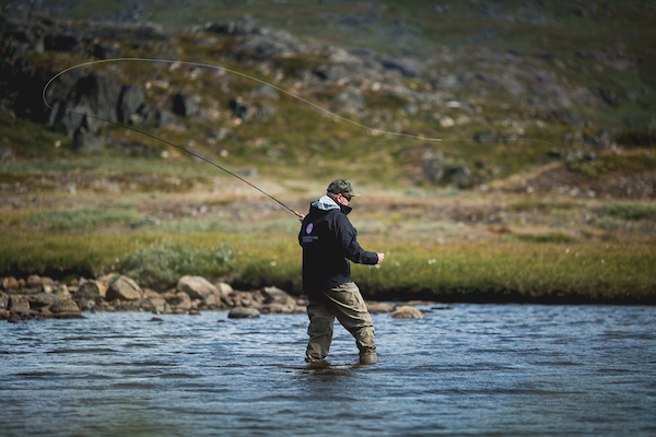 The guide from South Greenlanf Fly Fishing angling in the Narsaq backcountry.jpg