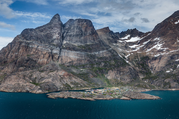 An aerial view of the village Aappilattoq in South Greenland and the peaks that dwarf this tiny town.jpg