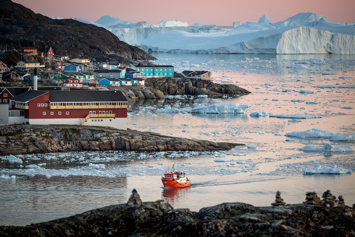 A passenger boat near Ilulissat and the ice fjord in Greenland.jpg