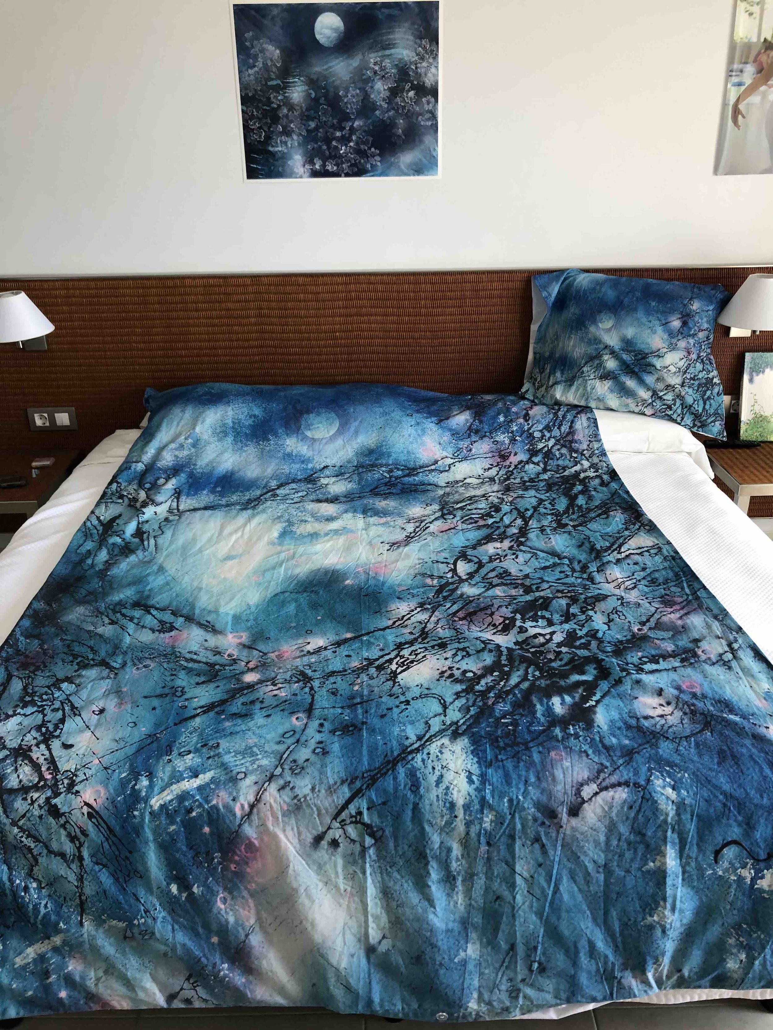 Sleeping in a bedcover with Meera's paintings!