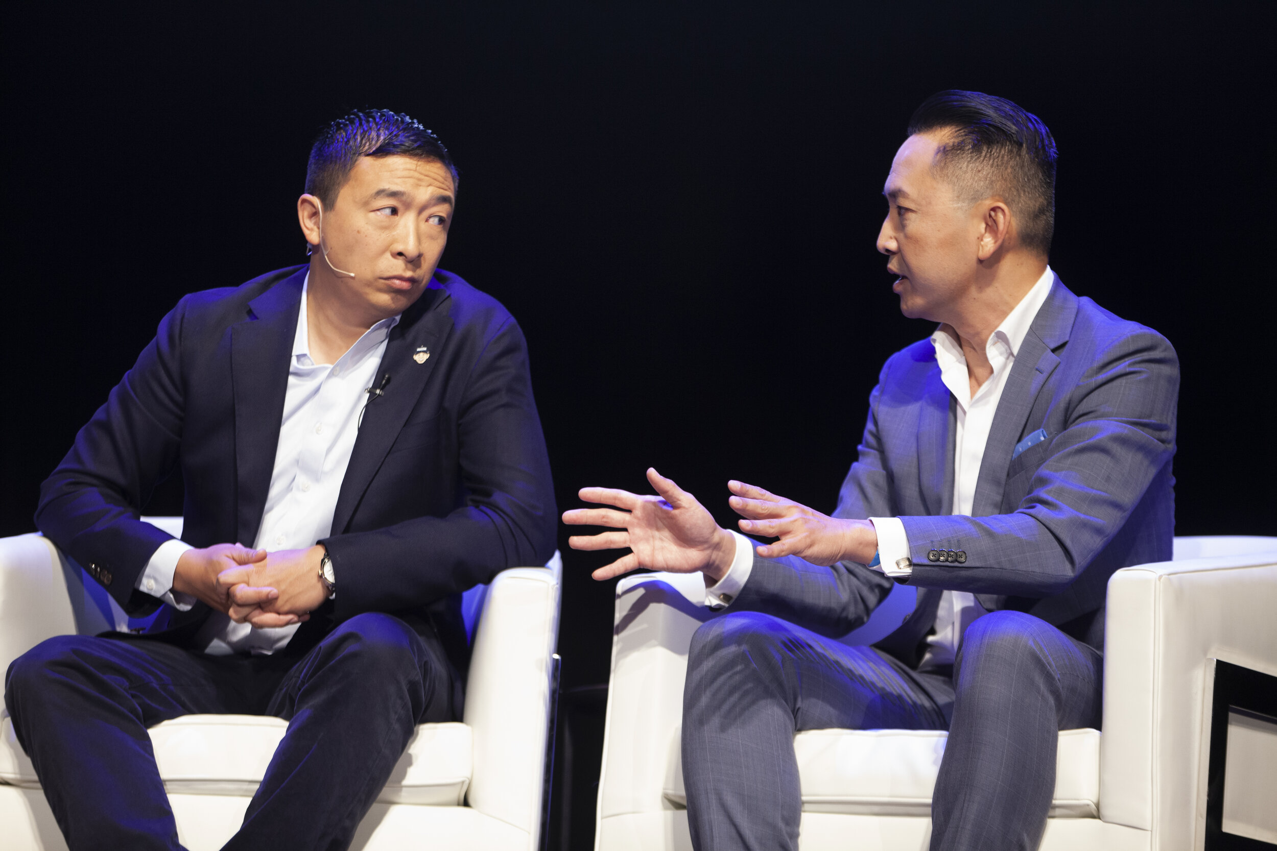 Presidential candidate Andrew Yang talks universal basic income with Pulitzer price-winning author Viet Thanh Nguyen on stage at the AAPI Democratic Presidential Forum.