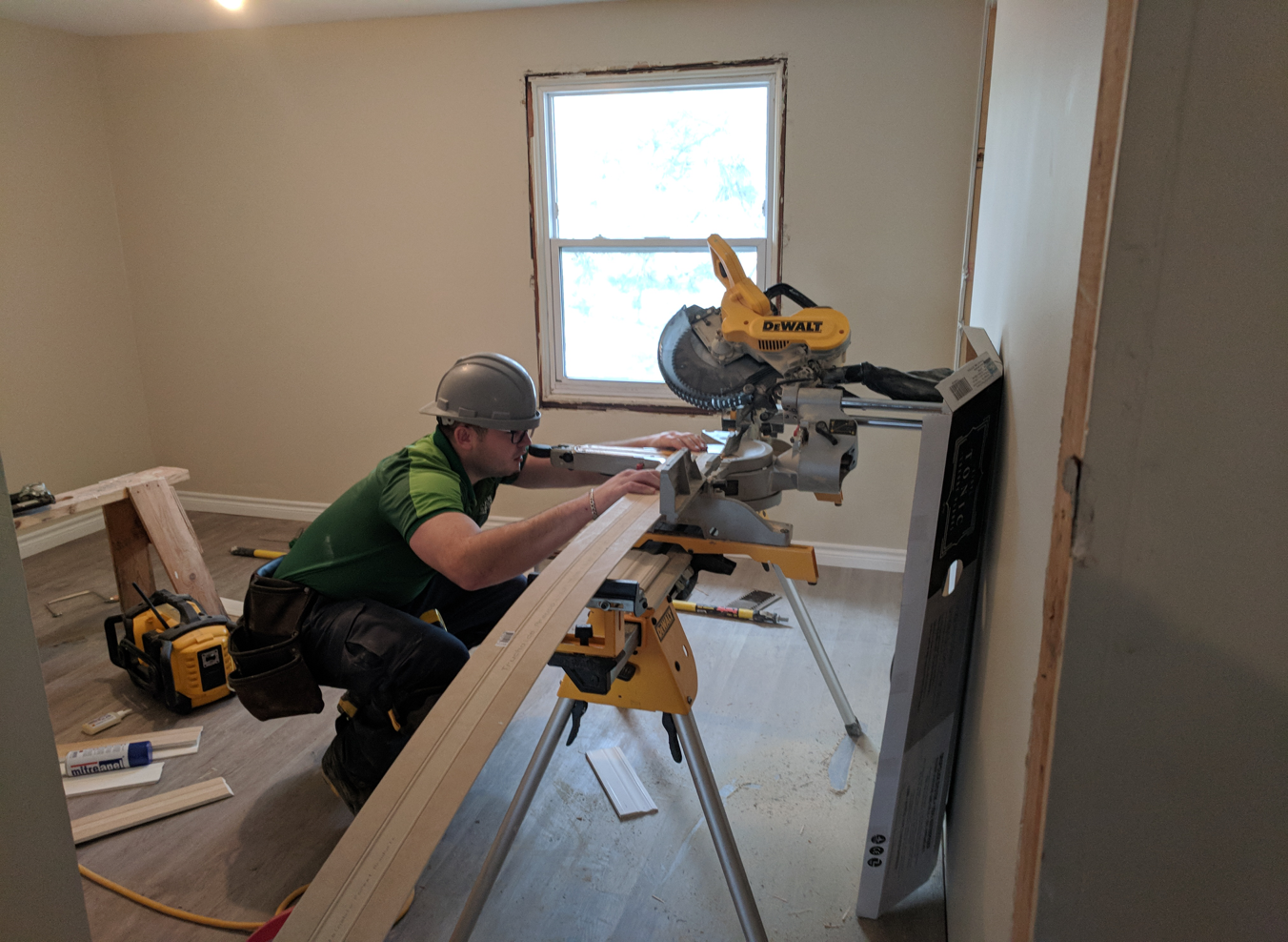Mohawk student cutting trim to size