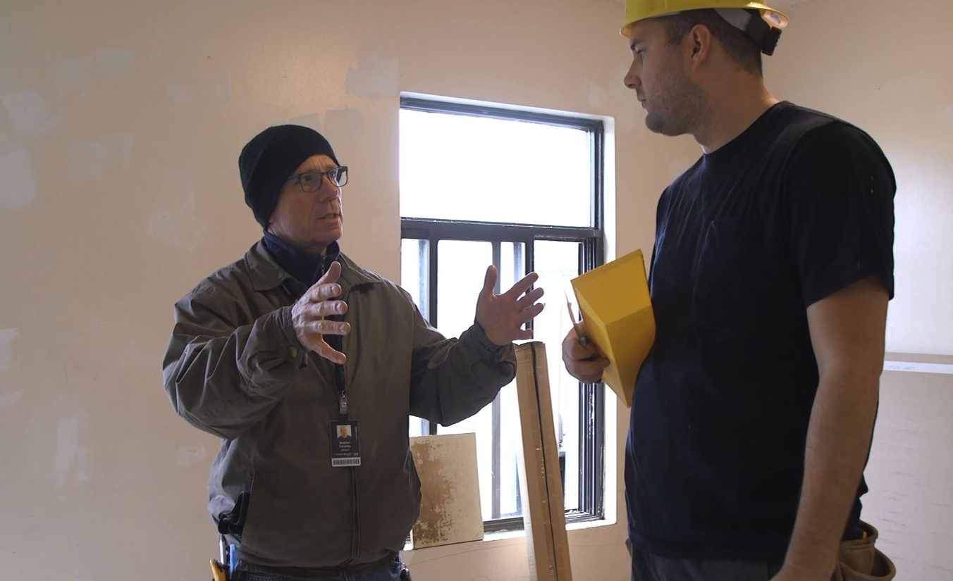 Mohawk instructor teaching a student on-site