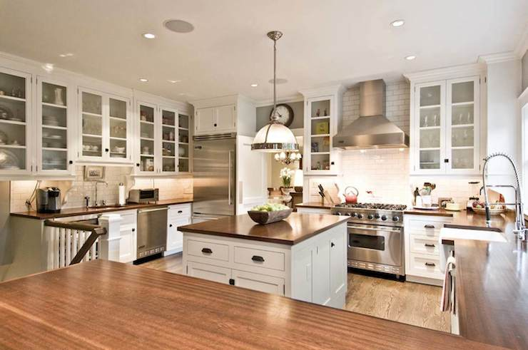 kitchen-remodeling-white-cabinets-glass-doors-island-design-stainless-steel-hood.jpg