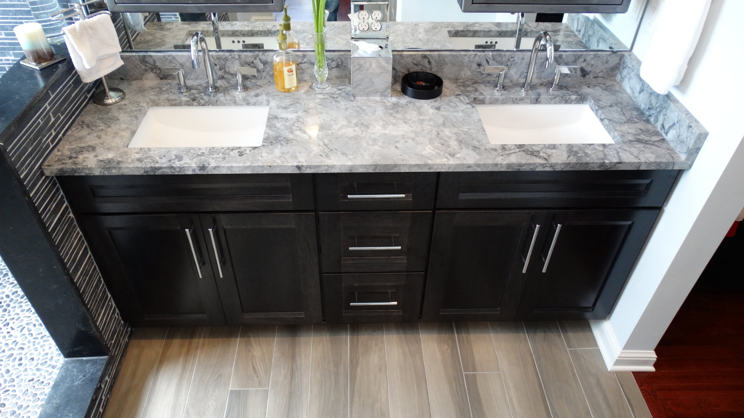 rocky-river-bathroom-renovation-heated-tile-floors-black-vanity-quartz-countertop.JPG