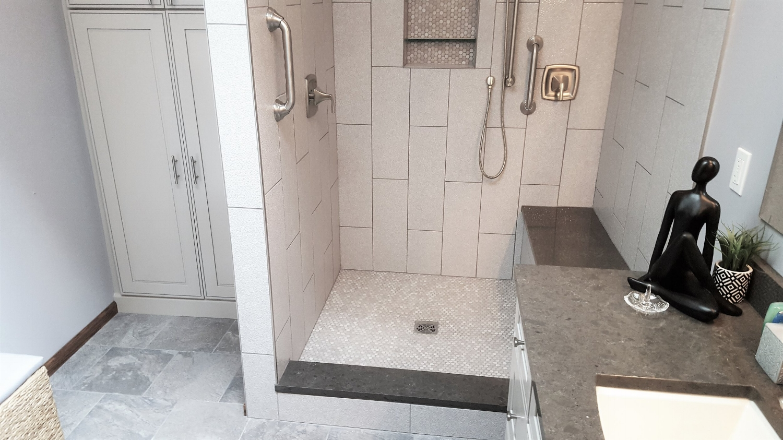 brecksville-ohio-bathrom-remodel-custom-cabinets-quartz-countertops-bench-tile-shower.jpg