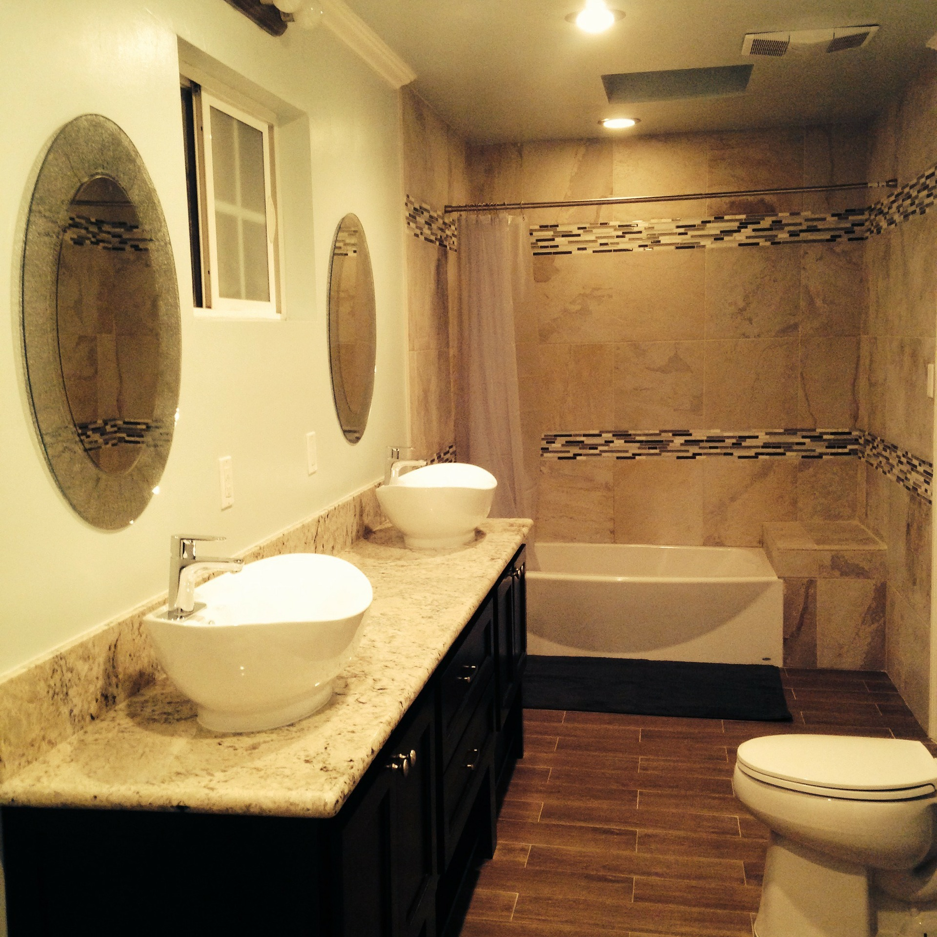 bowl-sink-bathroom-remodel-tile-accent-shower-wall.jpg
