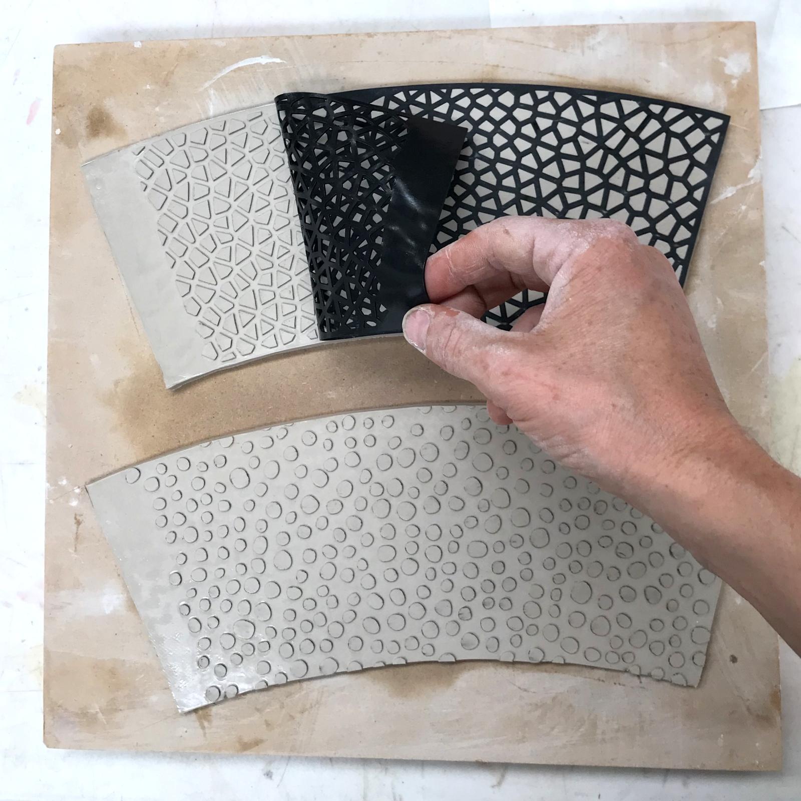 Peeling off a template.