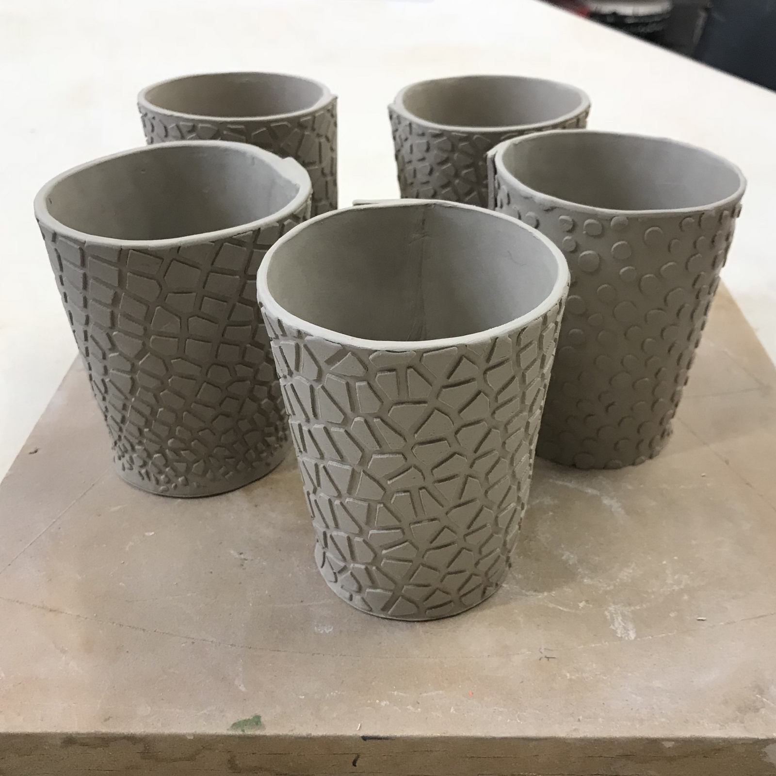 Cups in wet clay.