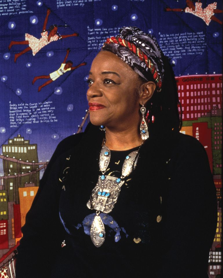 Faith Ringgold with her work Tar Beach 2, in 1996 © 2019 Faith Ringgold/Artists Rights Society (ARS), New York, Courtesy ACA Galleries; New York. Photo: Grace Matthews