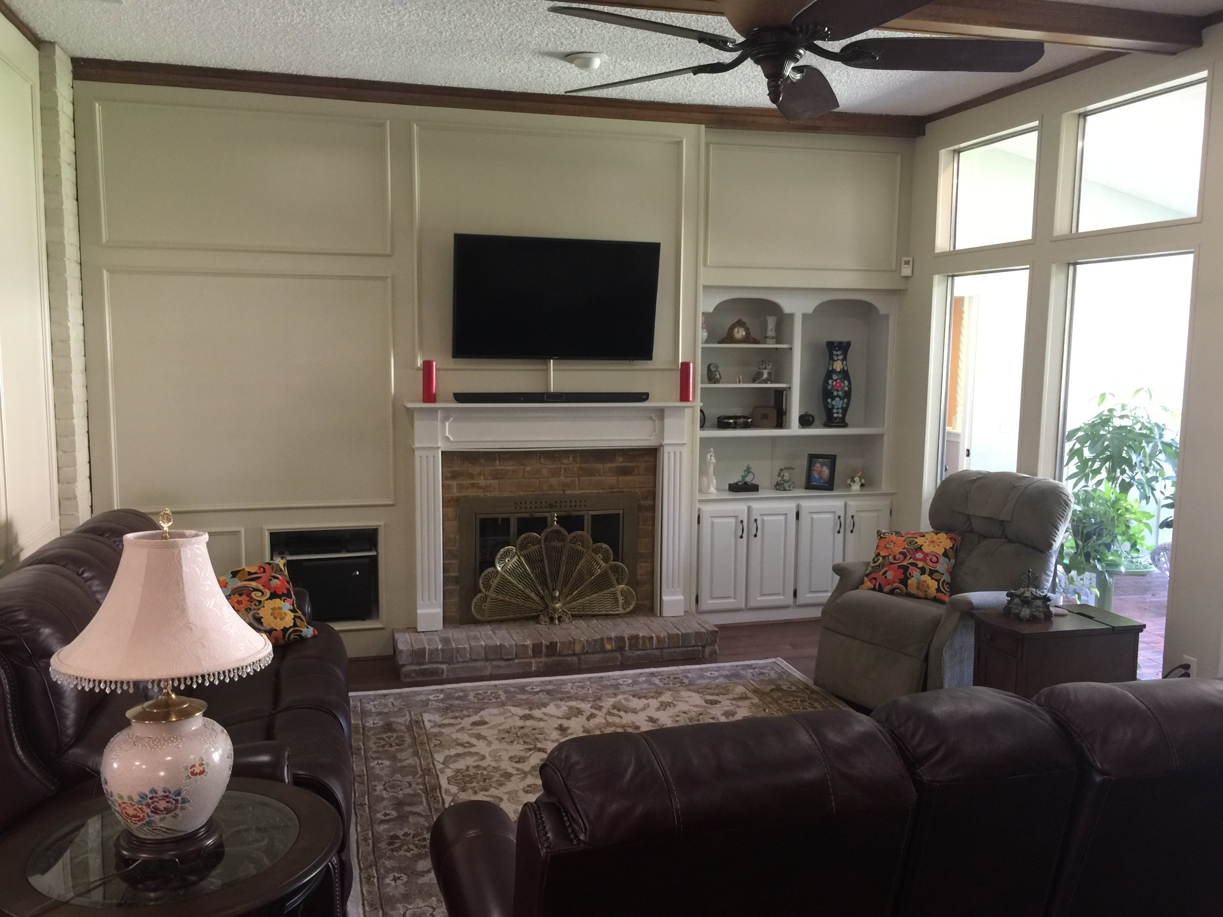 Interior reconstructed over brick with wall mounted TV