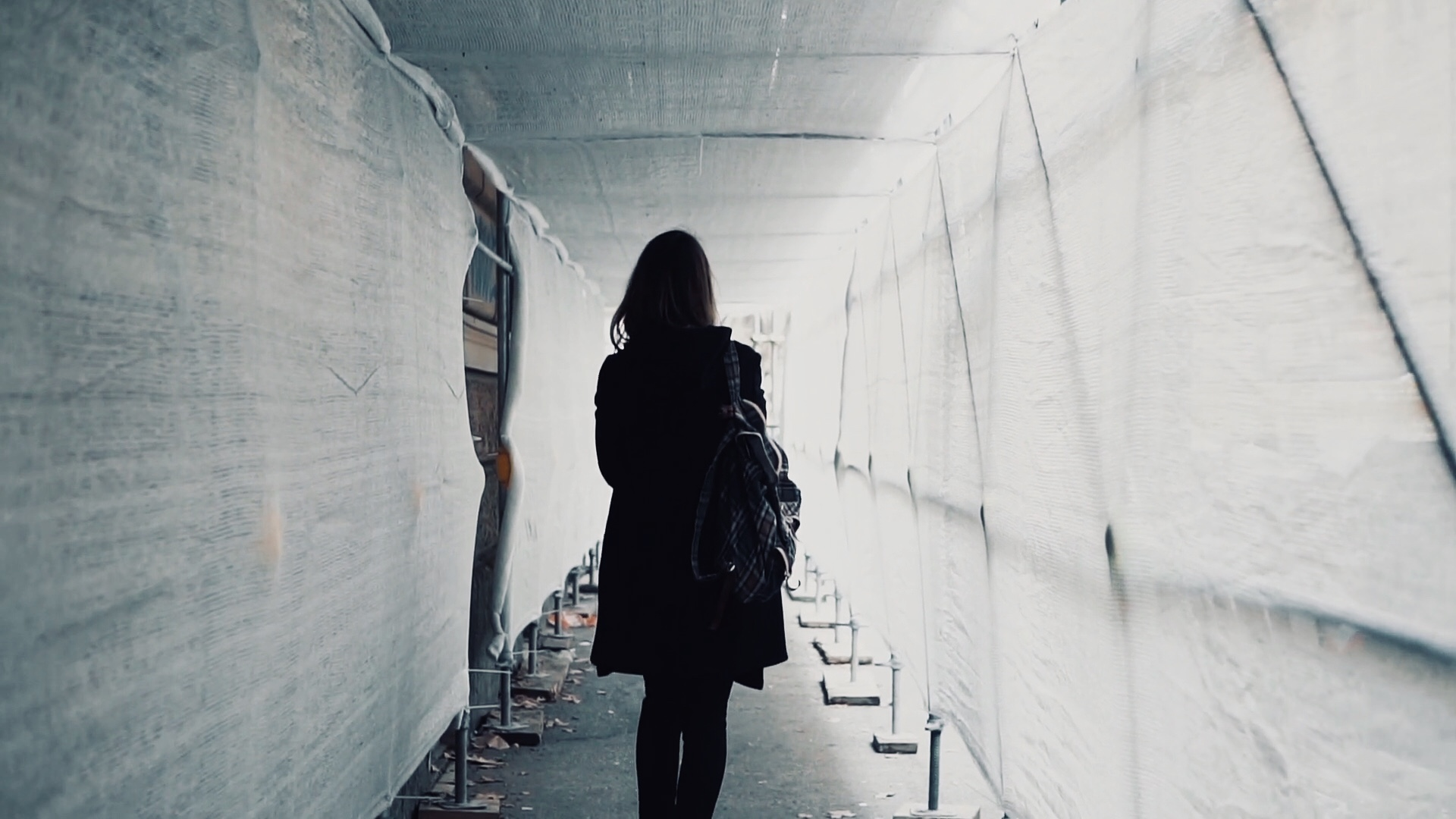 videoblocks-student-girl-walking-through-the-white-construction-corridor-back-view-of-young-woman-goes-to-work-across-the-building_rnllt3ldje_thumbnail-full08.jpg