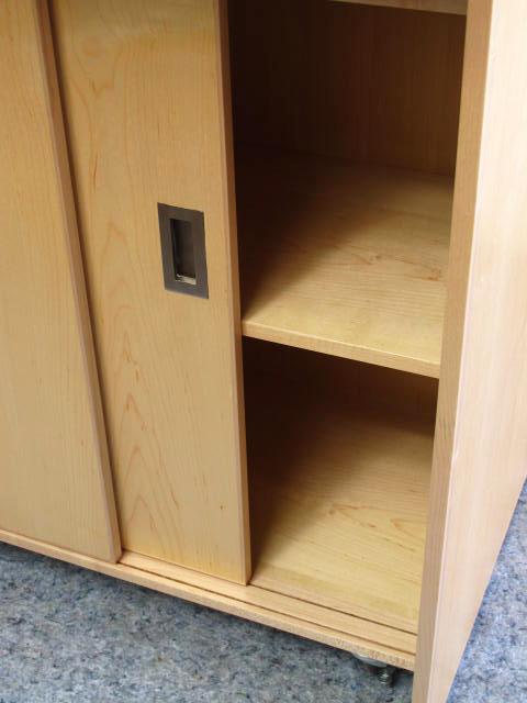 Sliding Doors Conceals Storage Space