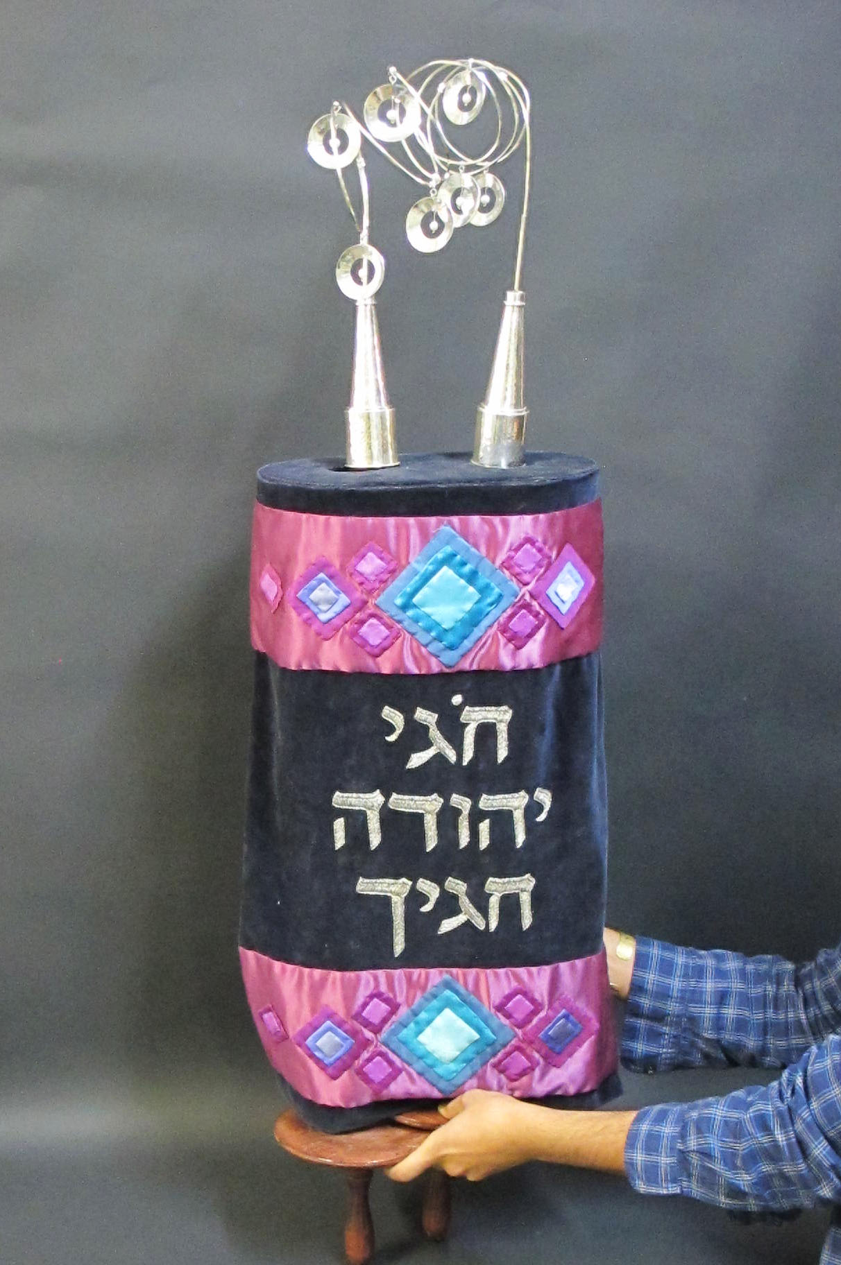Torah Rimonim and Crown on a Scroll.