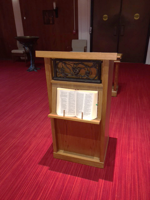 EPISCOPALIAN chapel  santa rosa, california.  the lectern is made of golden stained oak, embellished by a piece of reclaimed iron from the church's old staircase. note the set up for bible display at the front. -