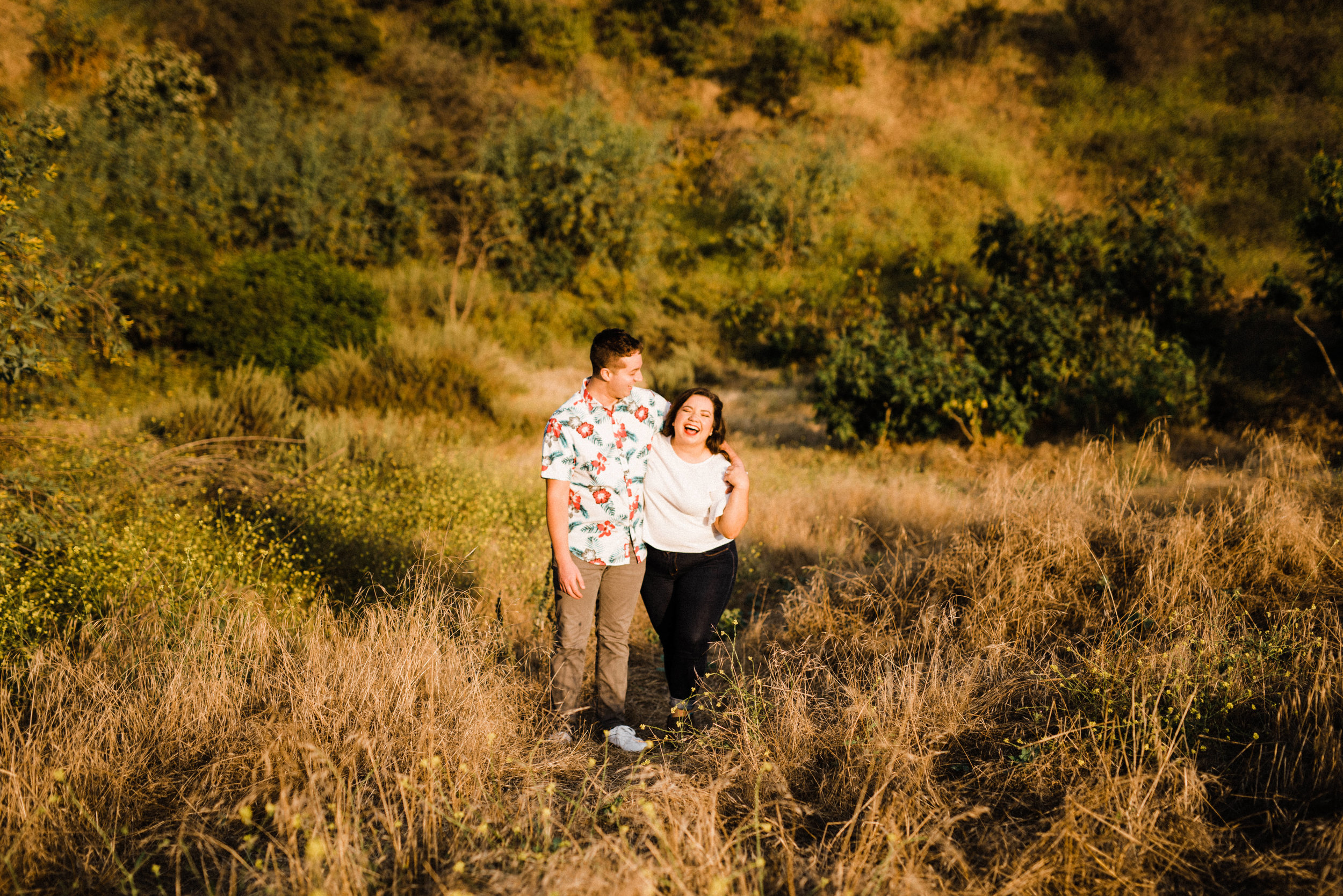 Couple walking on a trail at Bronson Canyon for their adventurous engagement shoot