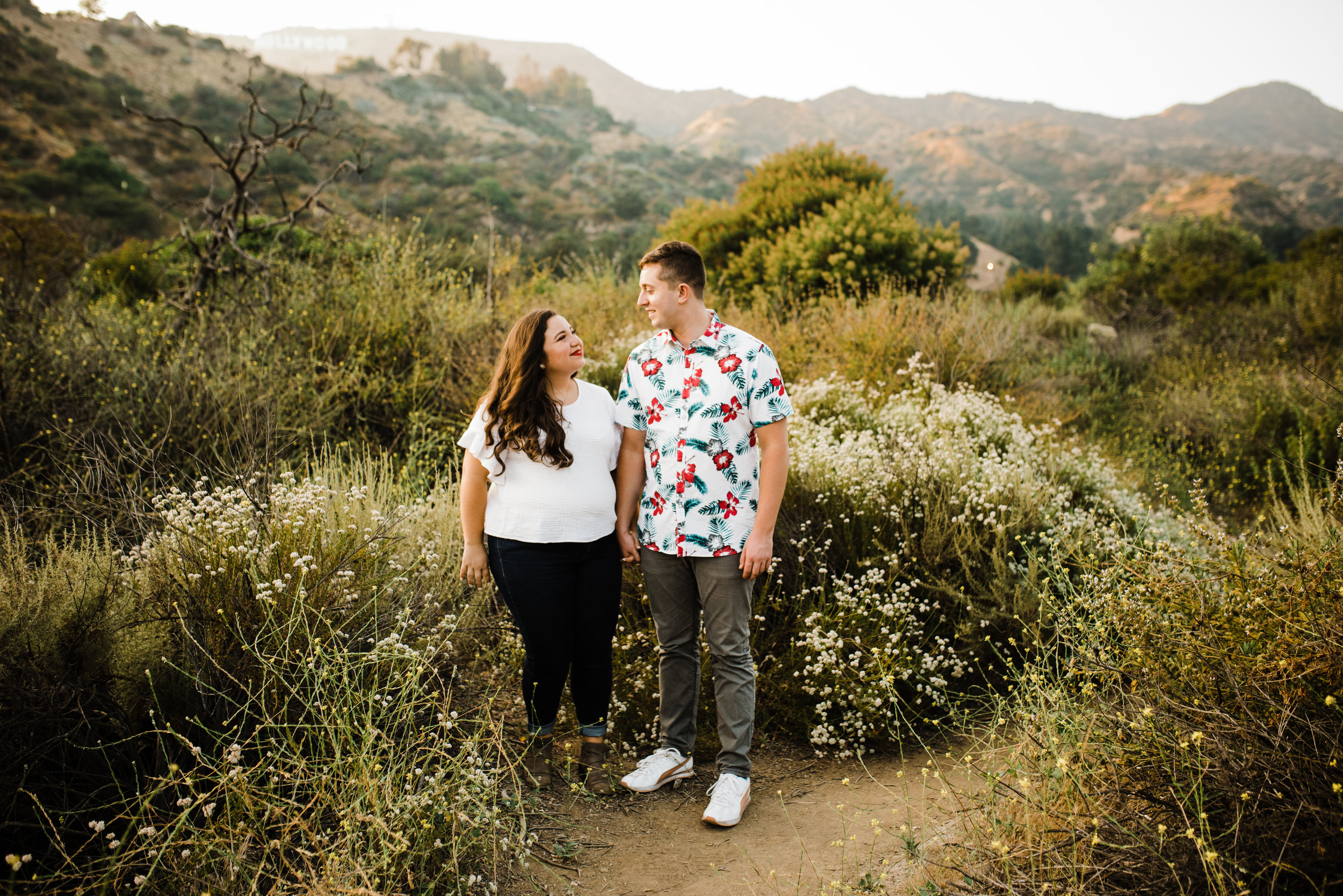 Happy couple during an adventurous Los Angeles engagement session at Bronson Canyon.