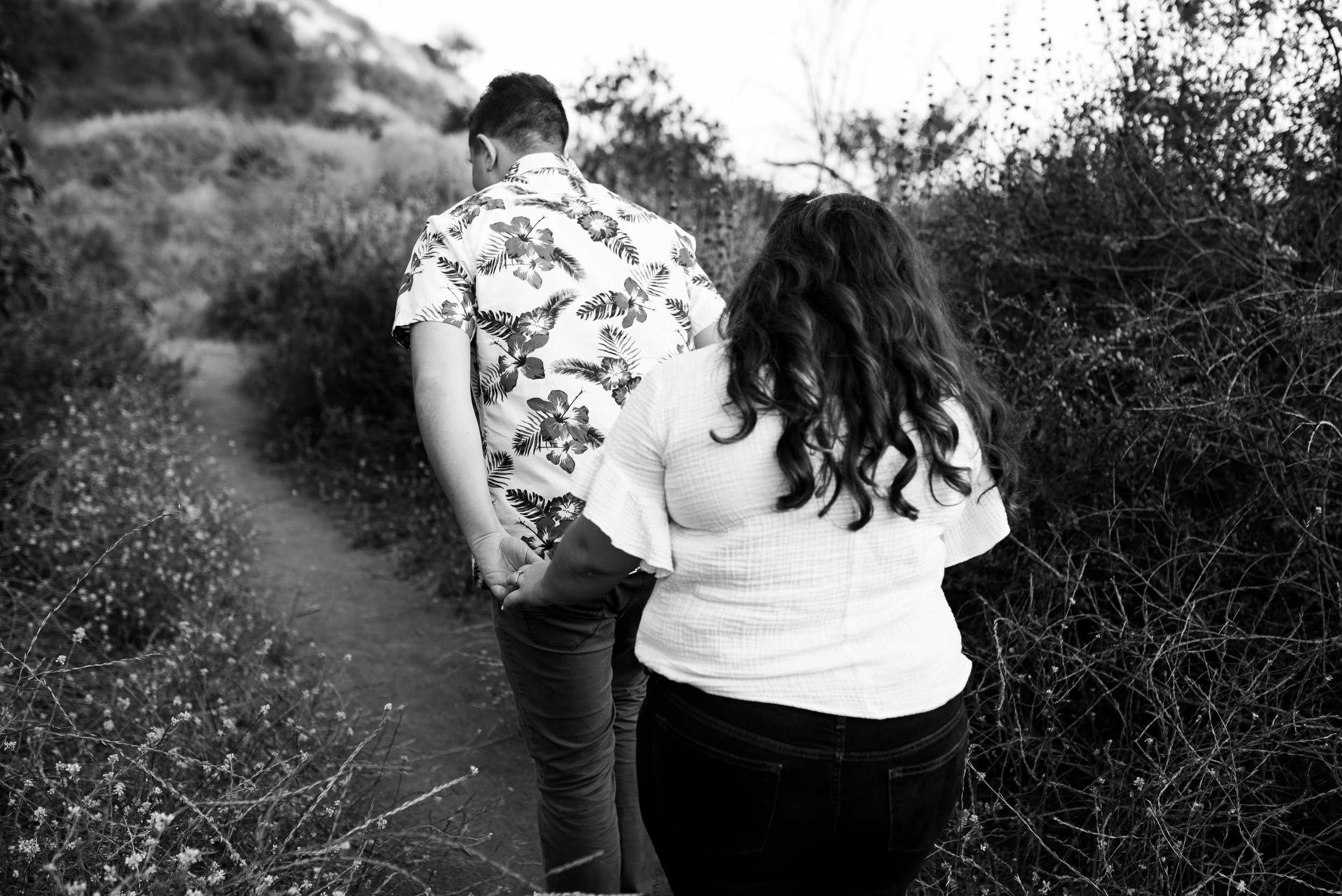 hipster couple walking the trails of Bronson Canyon for their adventurous Los Angeles engagement session