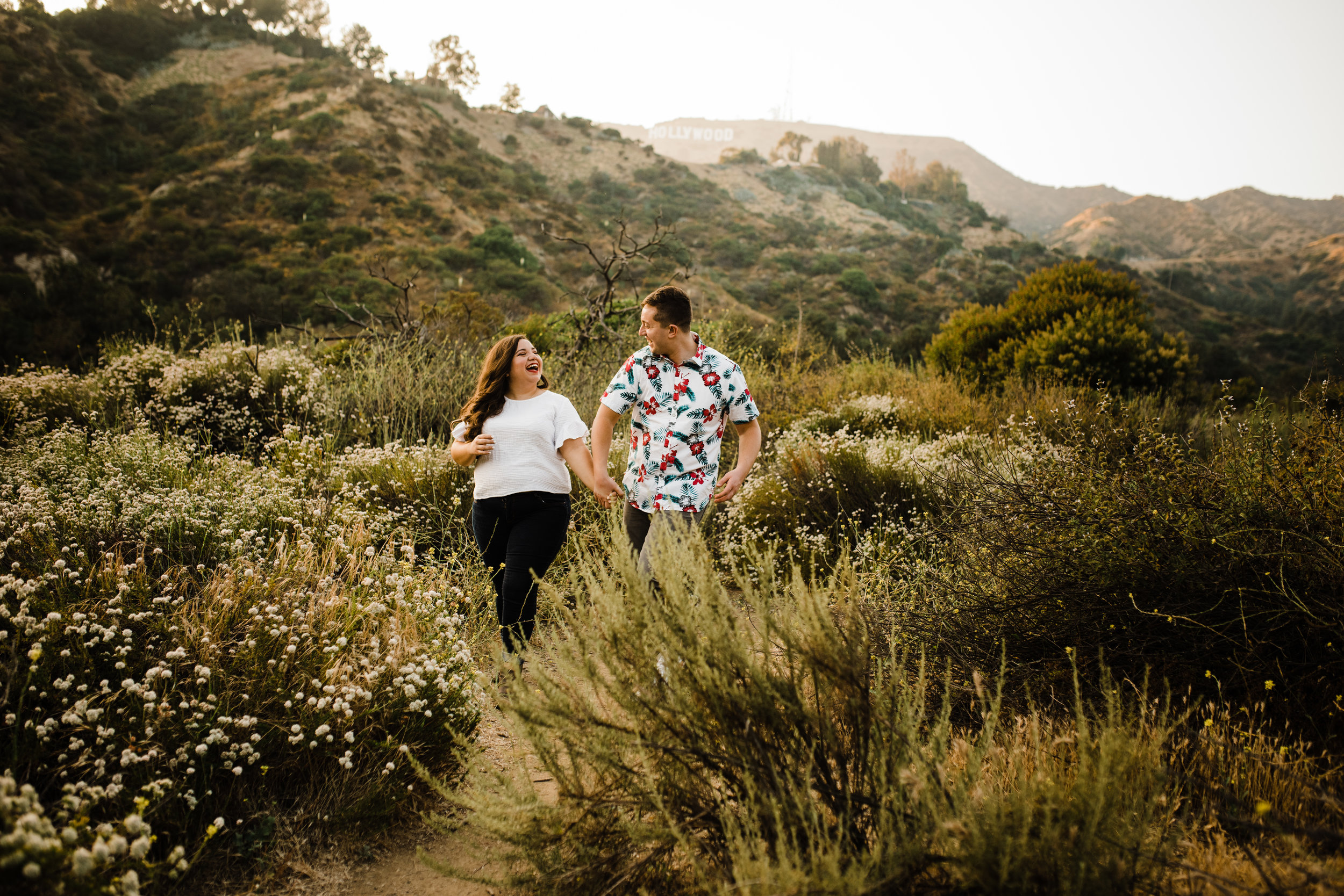 Couple hiking the trails of Bronson Canyon for their adventurous Los Angeles engagement session