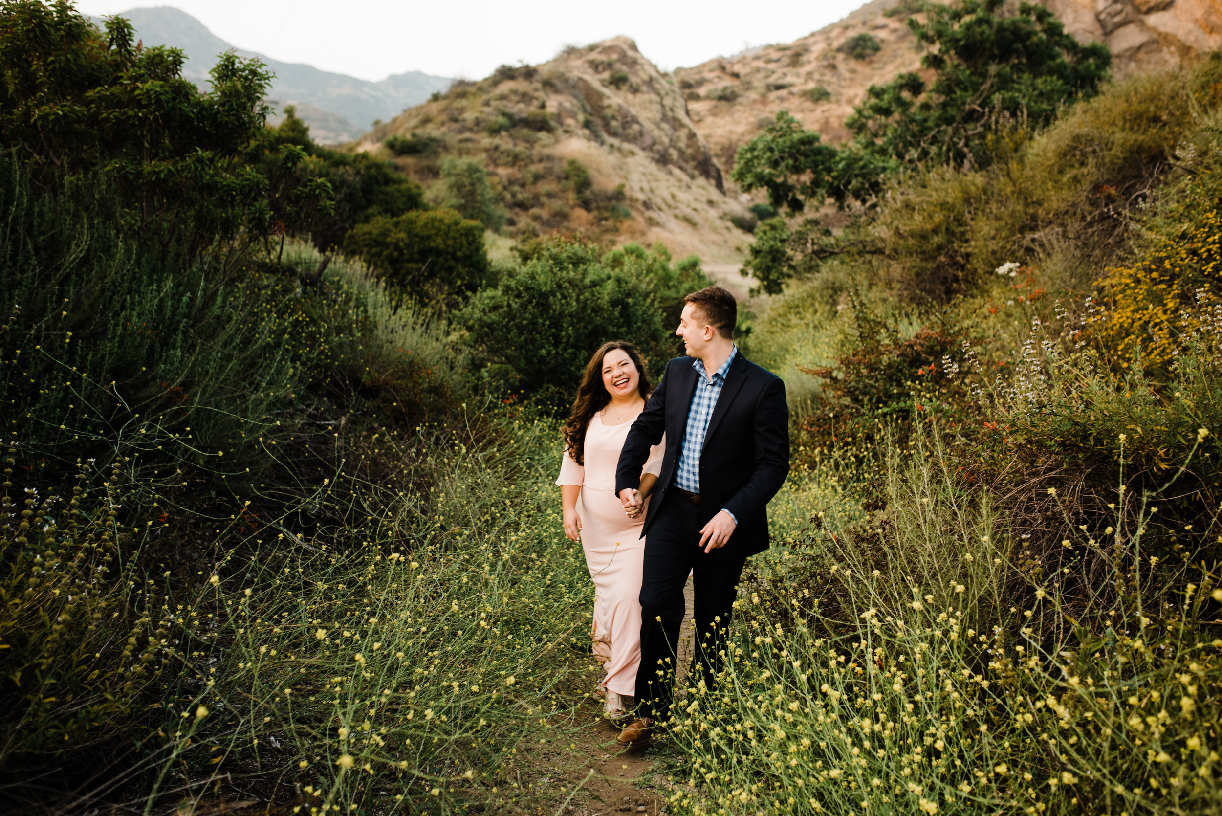Adventuring through LA's Bronson Canyon, engaged couple walking together