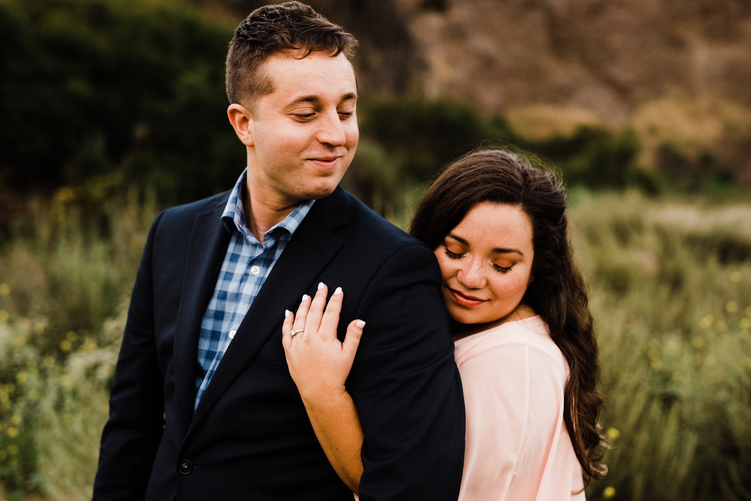 Engaged couple wearing pink and blue at their adventurous couples session in LA