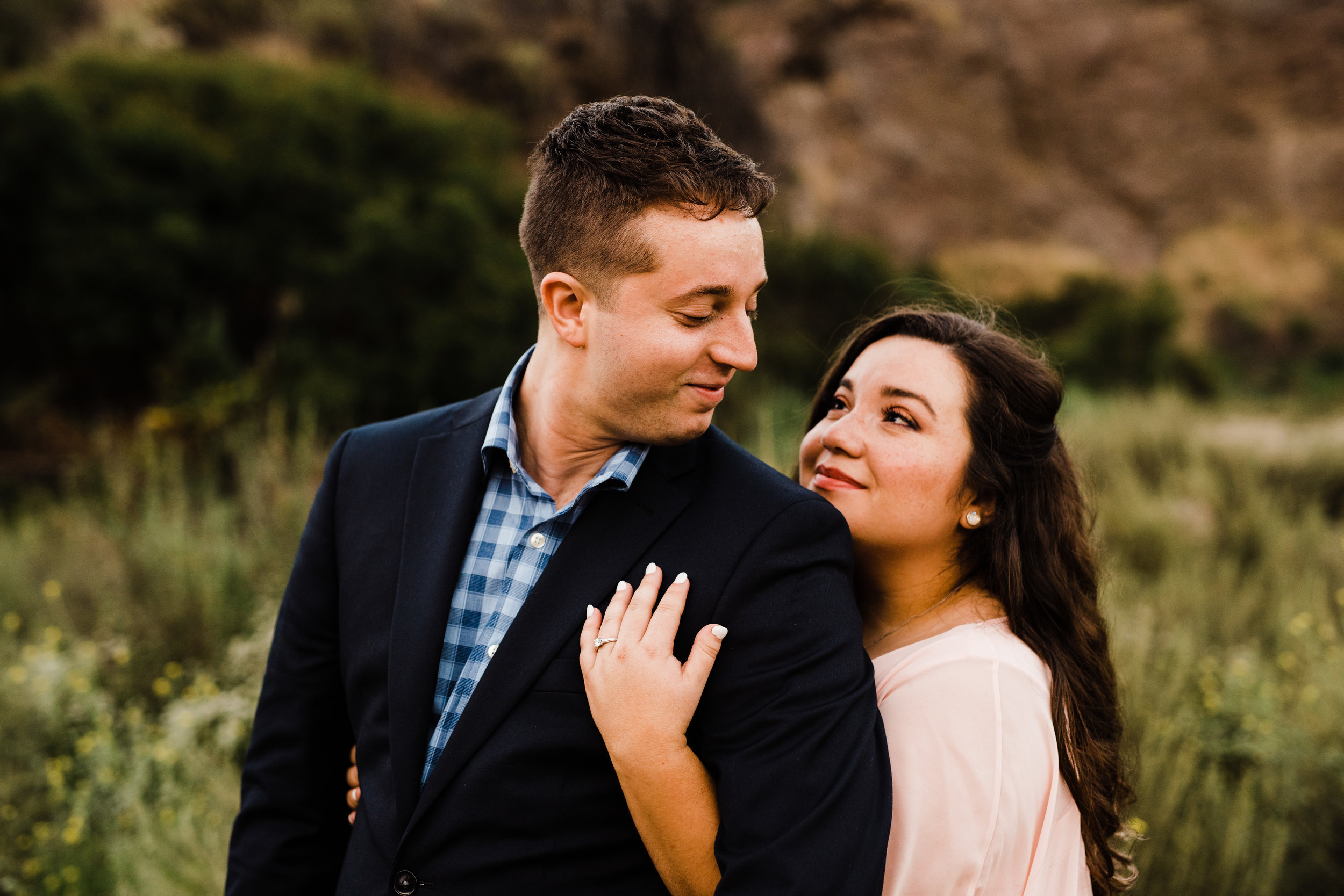 Semi-formal engagement outfits at adventurous engagement session in LA