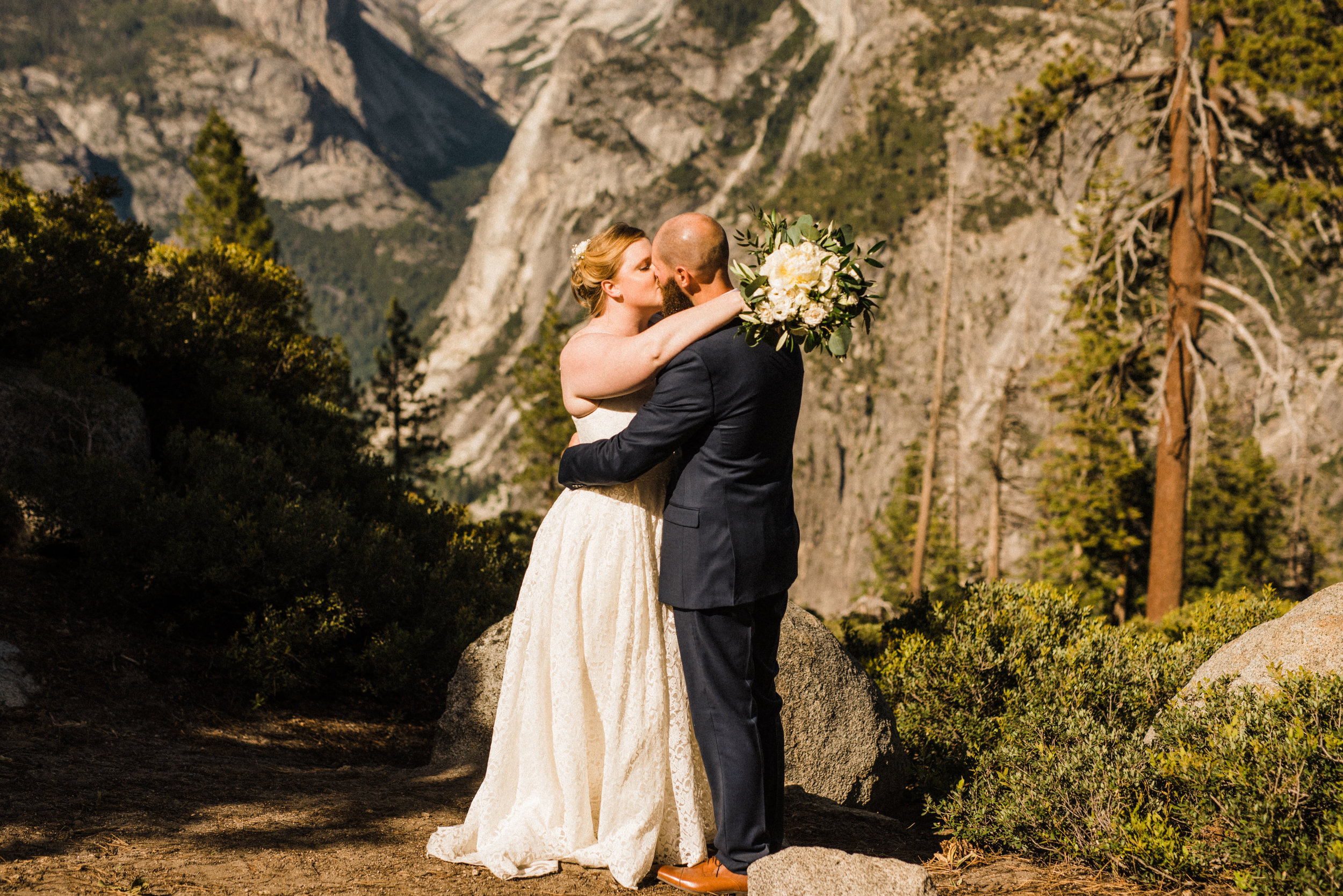 Bride and Groom on the cliff at Glacier Point in Yosemite