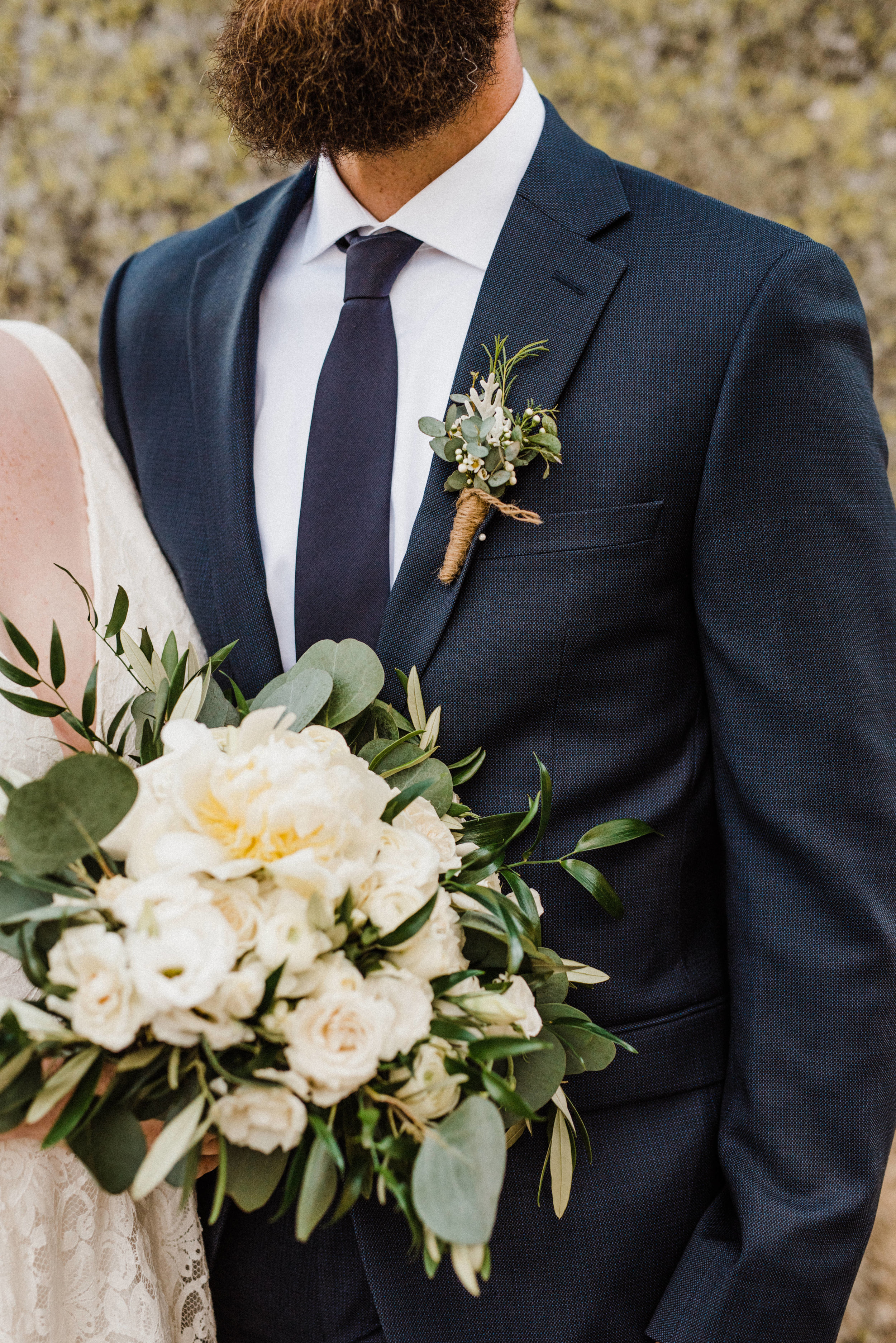 Romantic and classic eucalyptus and white rose floral bouquet and boutonniere at Glacier Point elopement