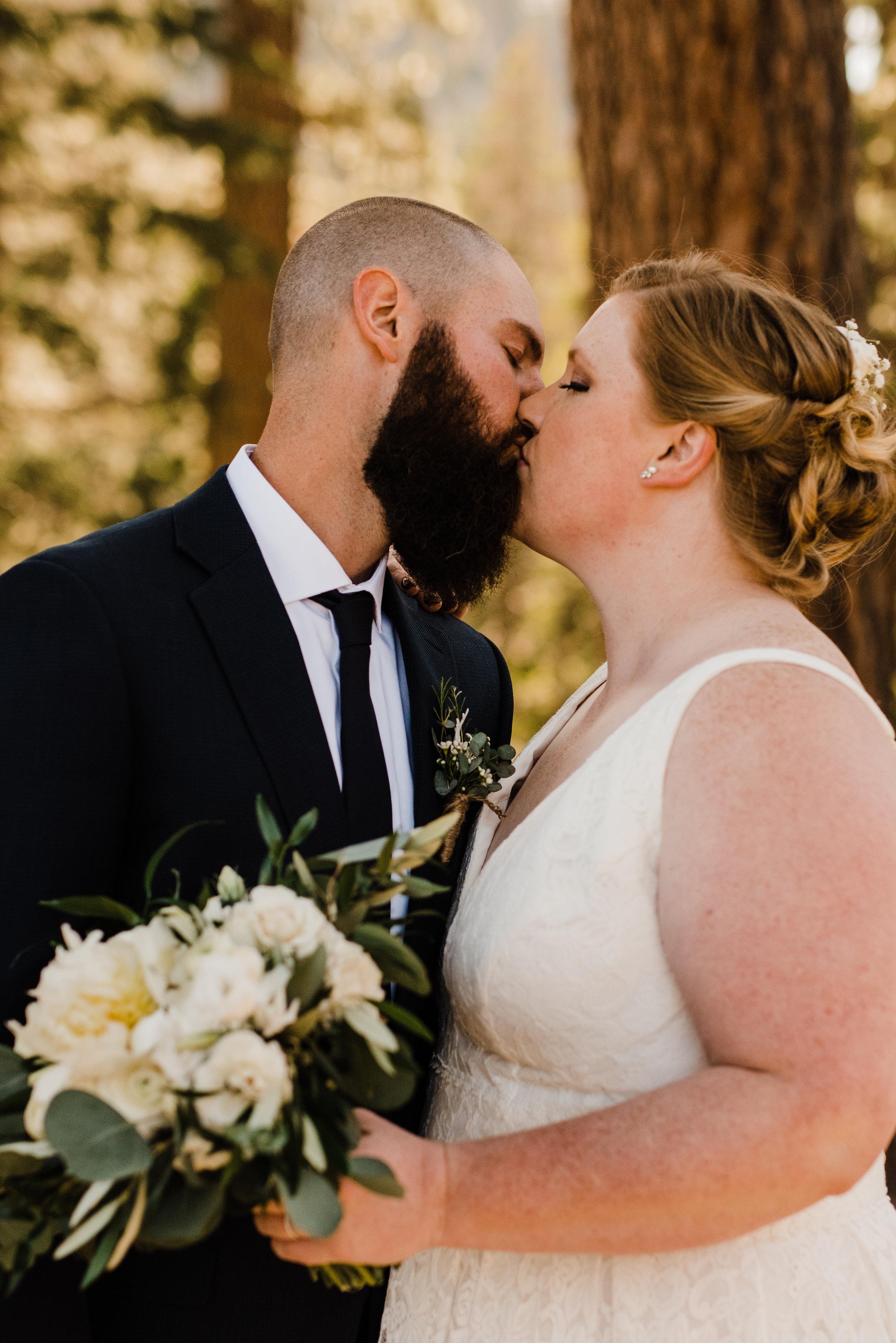 Summer Bride and Groom Kiss Beneath Trees at Yosemite National Park