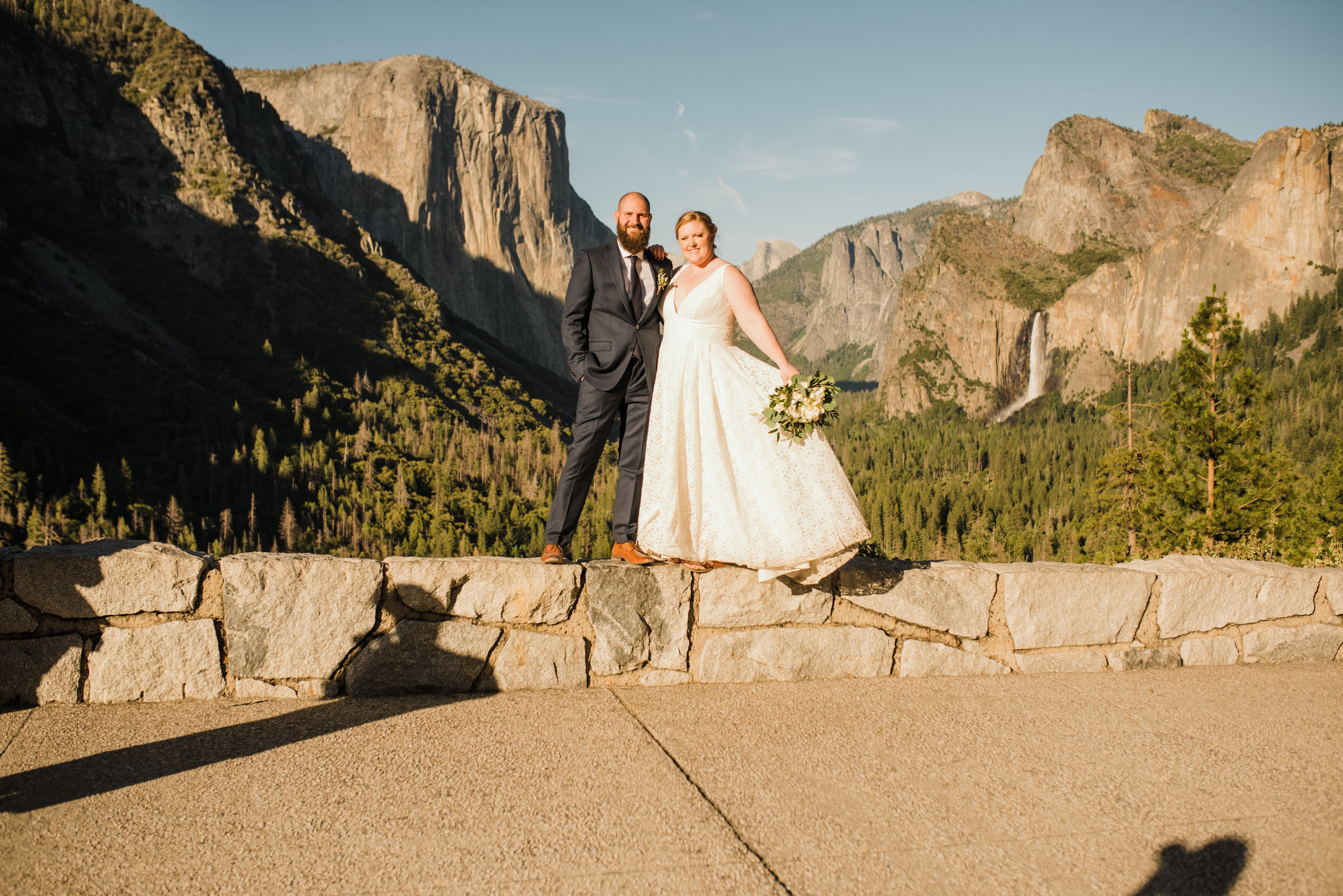 Married couple after Glacier Point Ceremony Standing in front of Half Dome and El Capitan at Yosemite's Tunnel View
