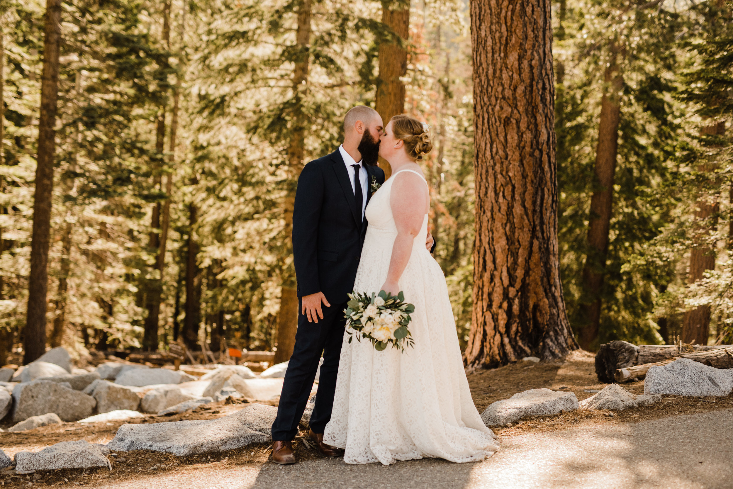 Bride and Groom on a trail at Yosemite Elopement