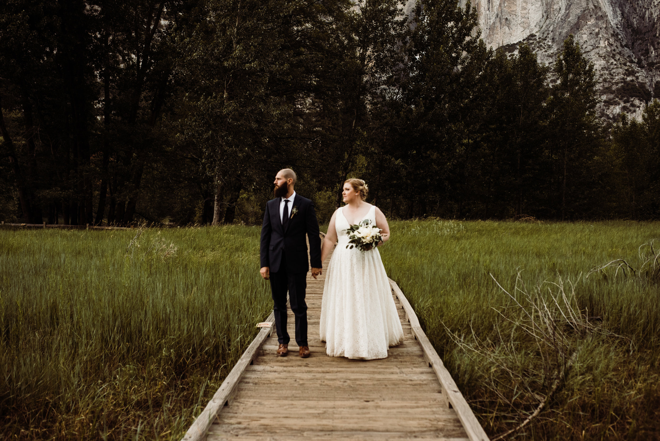 Adventurous couple exploring Yosemite Valley after their elopement ceremony