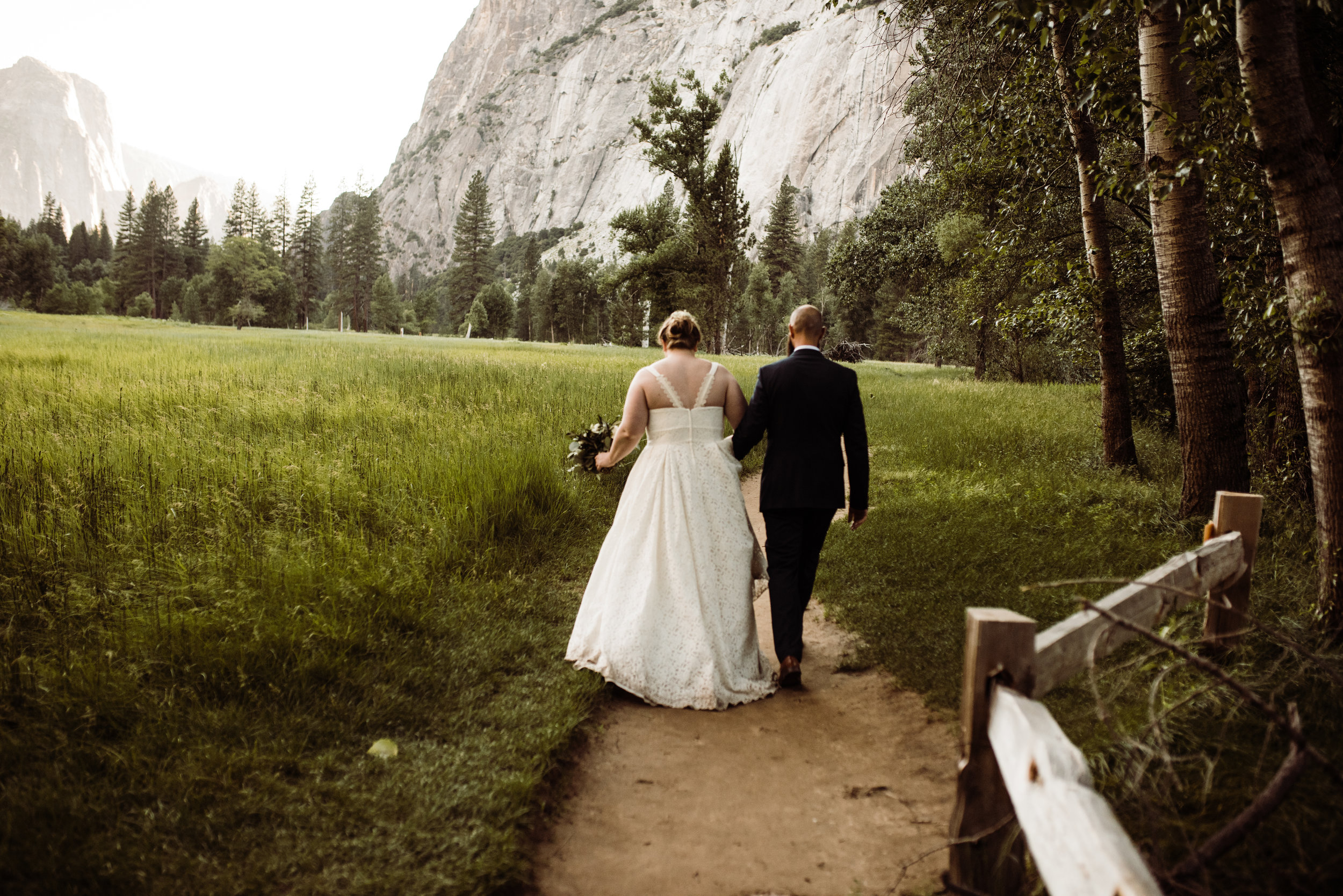 Couple walking on trail at Yosemite Valley after National Park elopement