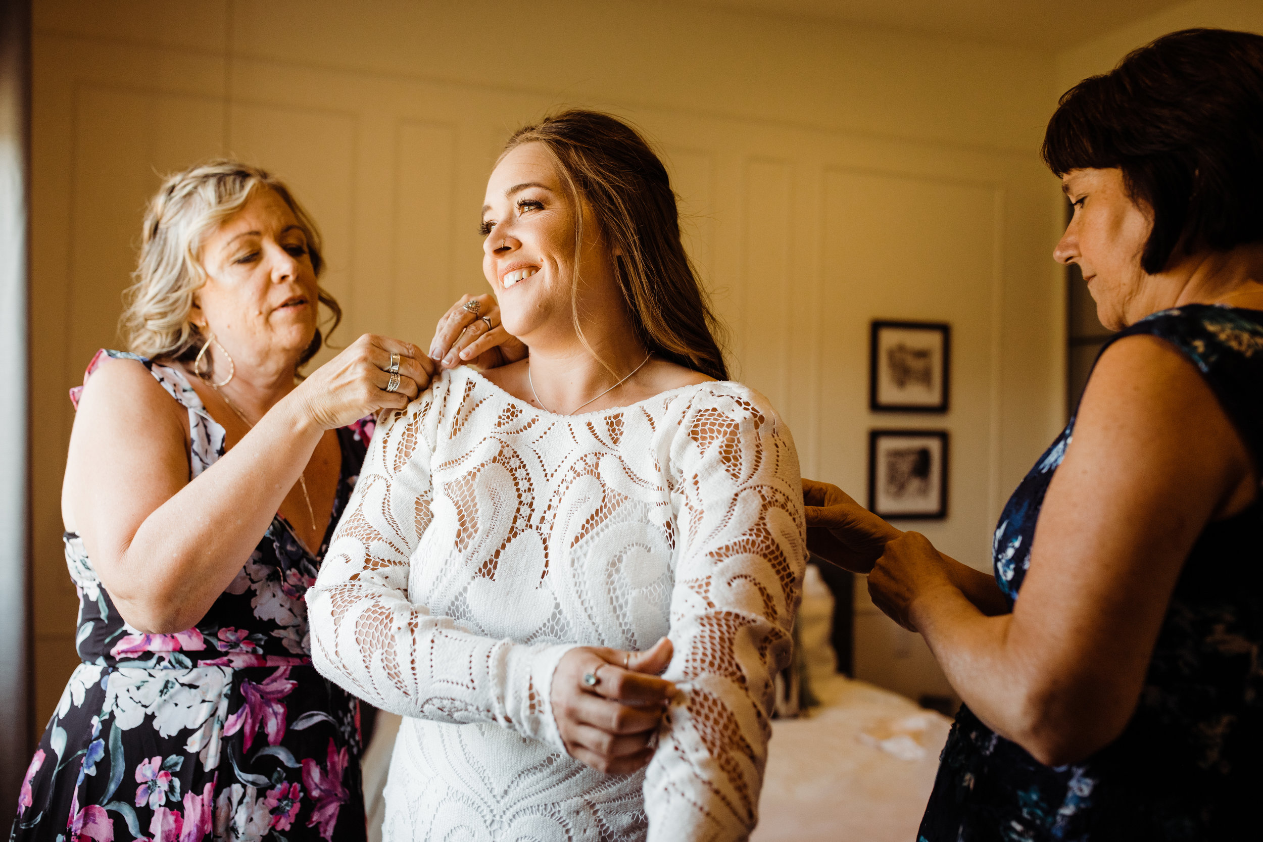 Bride in Lovers Society Boho Crochet dress getting ready with mother of the bride and mother of the groom at Serenity Escape JT