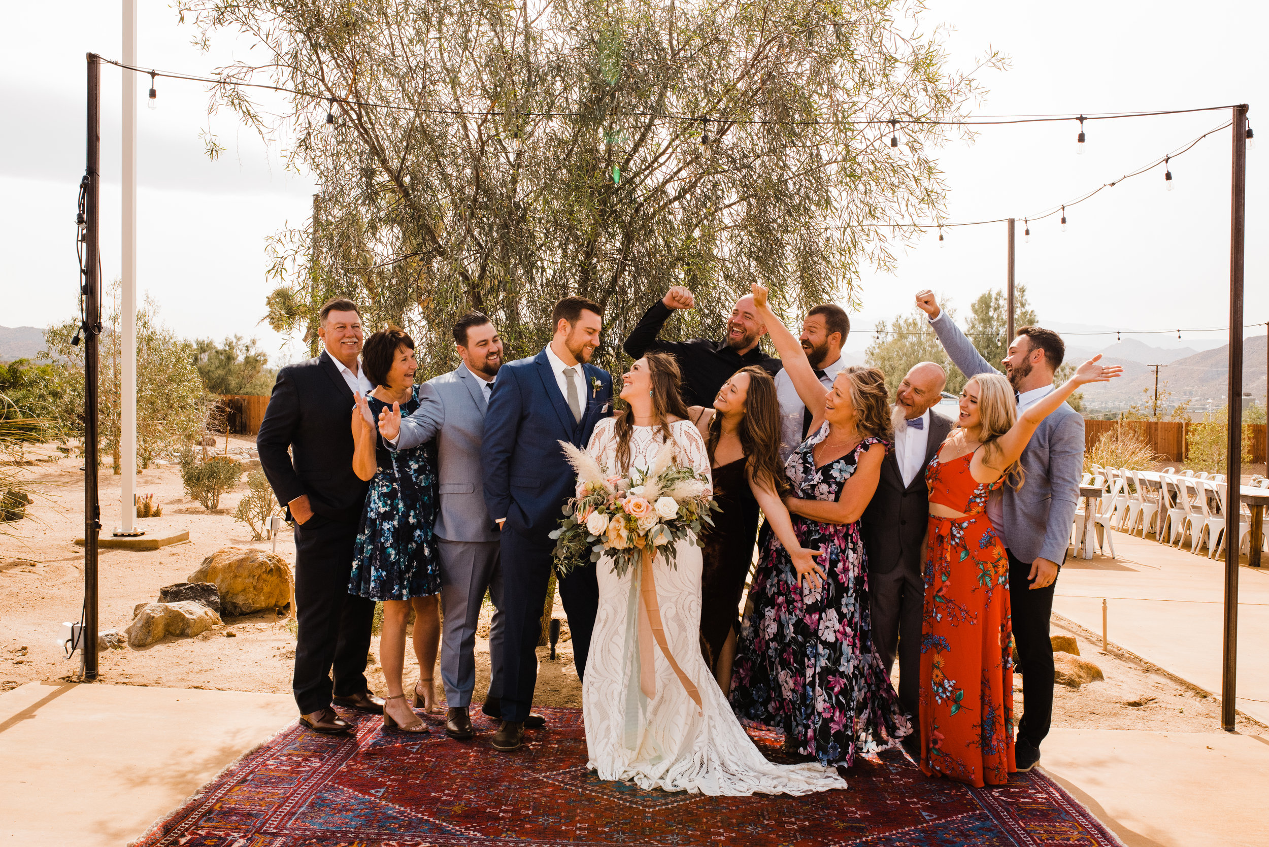 Family Cheers in Group Photo at Tumbleweed Sanctuary and Garden in Yucca Valley, California.