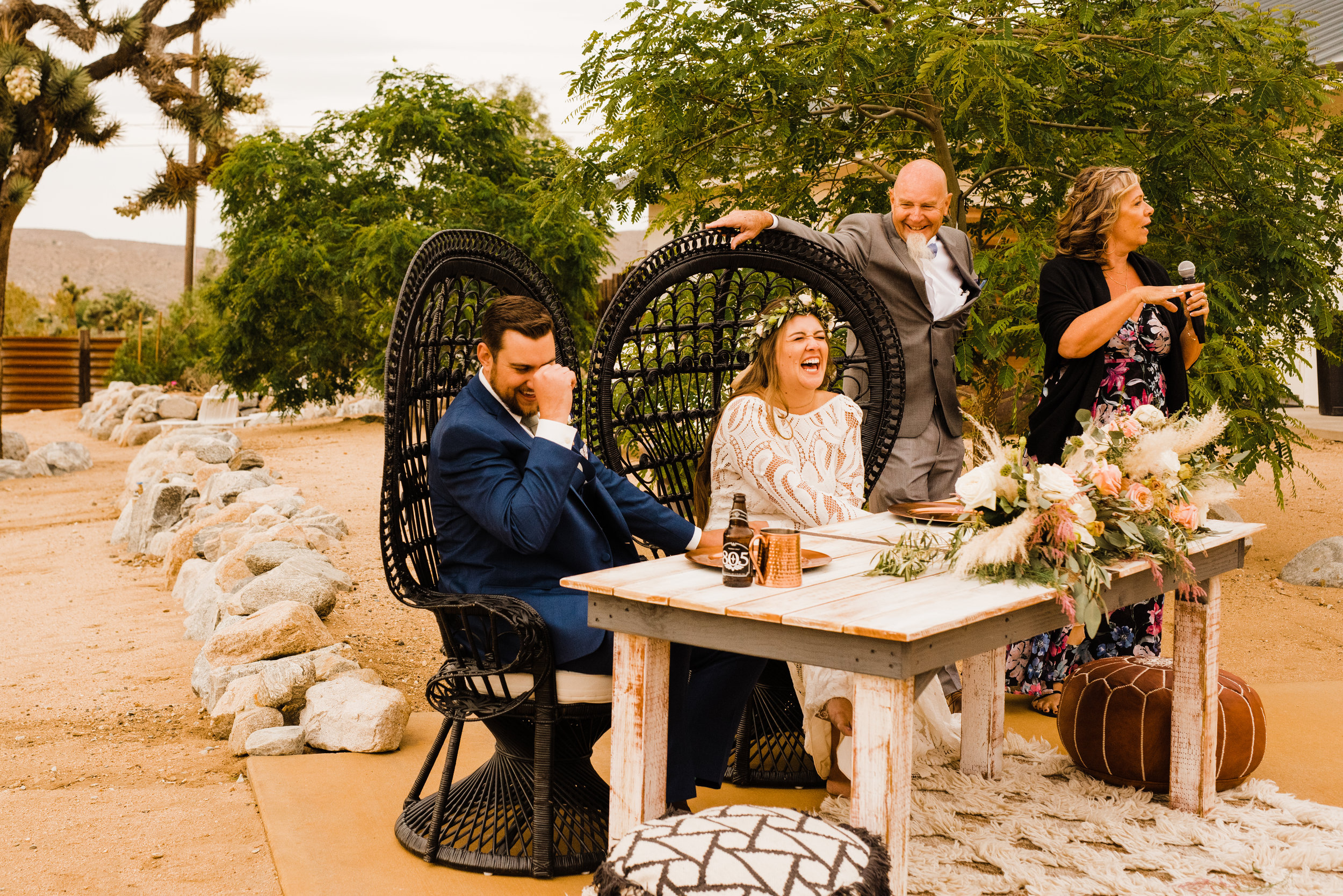 Bride and Groom laughing during toasts at Tumbleweed Sanctuary Reception