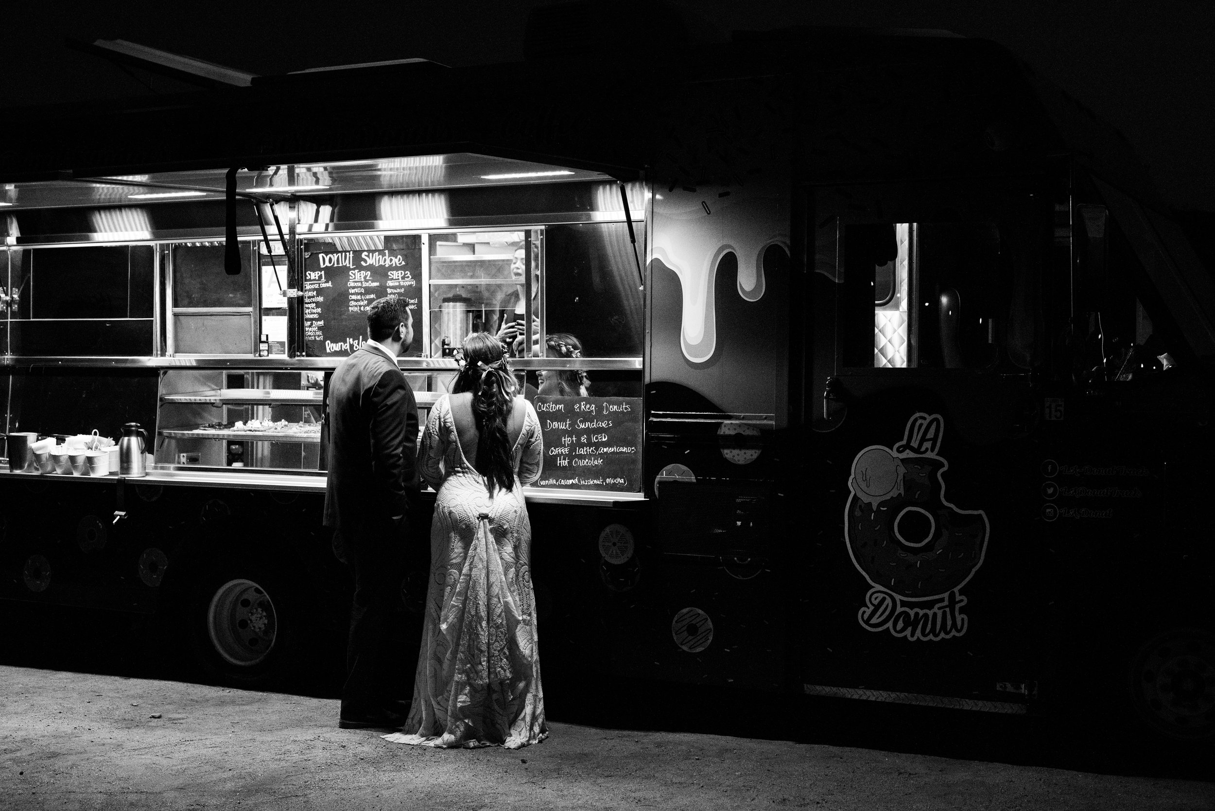 Bride and Groom ordering from LA Donut Truck at Tumbleweed Sanctuary and Garden Reception