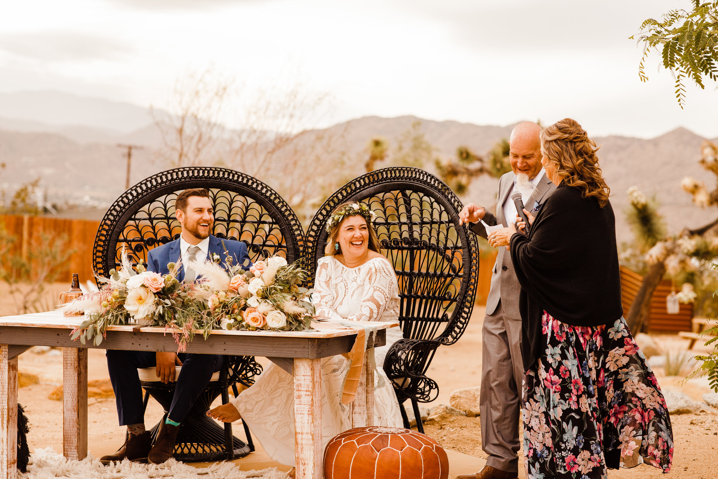 Bride and Groom laughing during toasts by mother of the bride at tumbleweed sanctuary wedding reception
