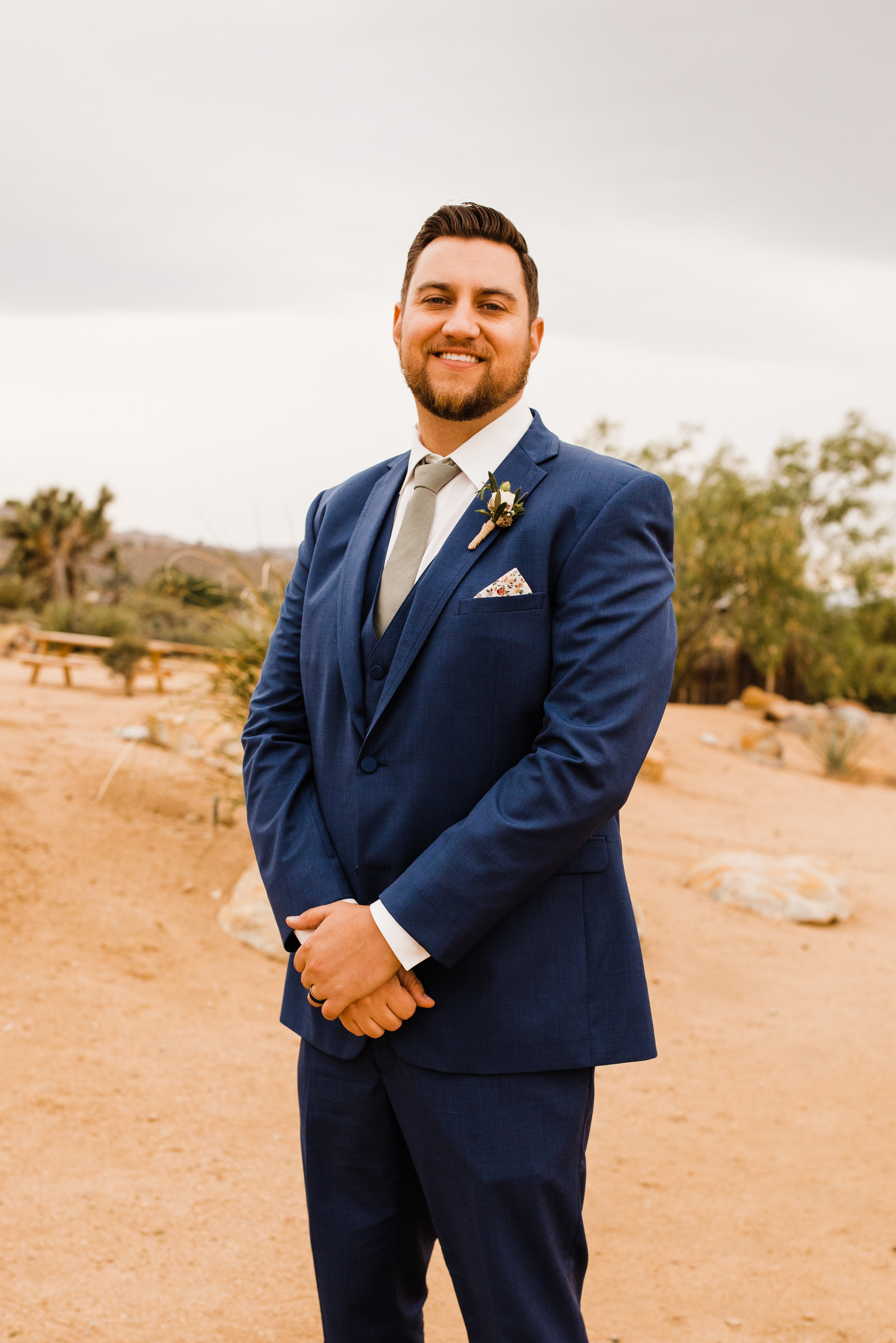 Groom in Blue Suit by Friar Tux at Tumbleweed Sanctuary Garden