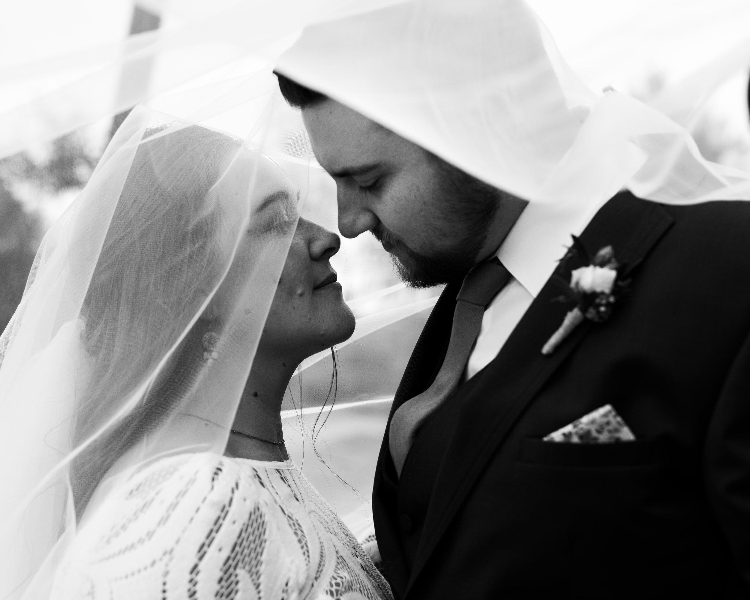 Bride and groom beneath veil at tumbleweed sanctuary wedding