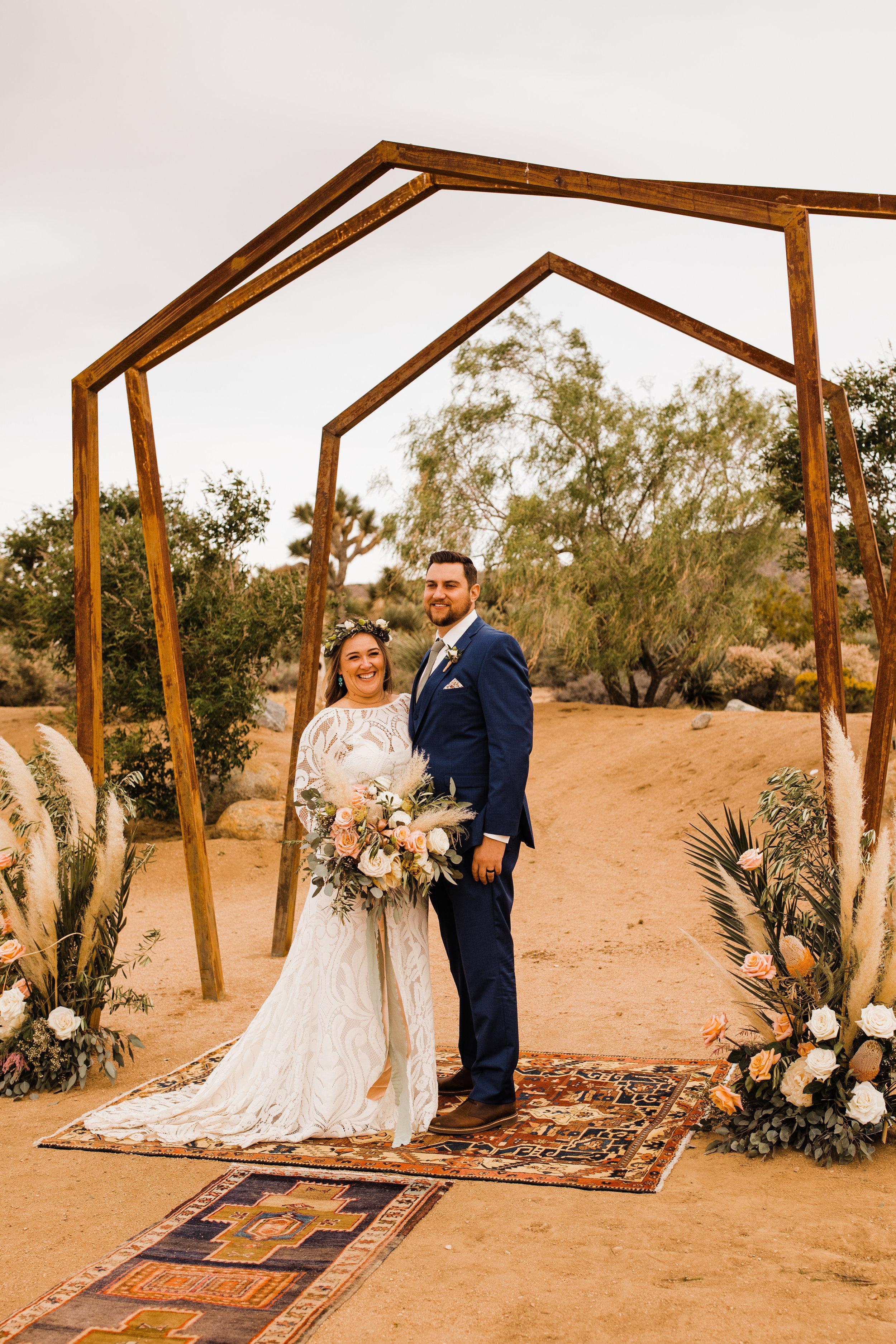 bride and groom beneath metal geometric arch at tumbleweed sanctuary wedding