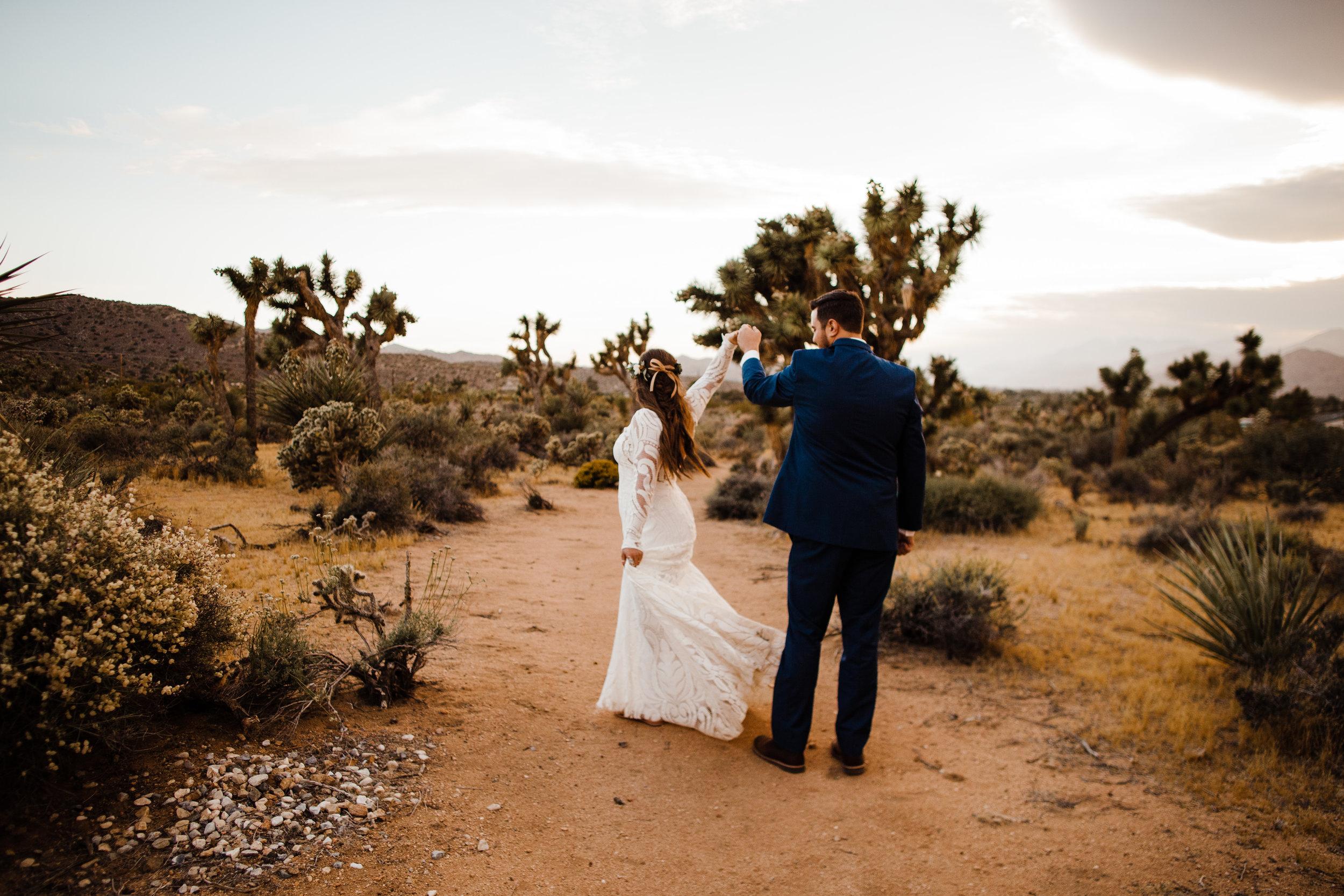 bride and groom dancing in the desert of joshua tree being tumbleweed wedding venue
