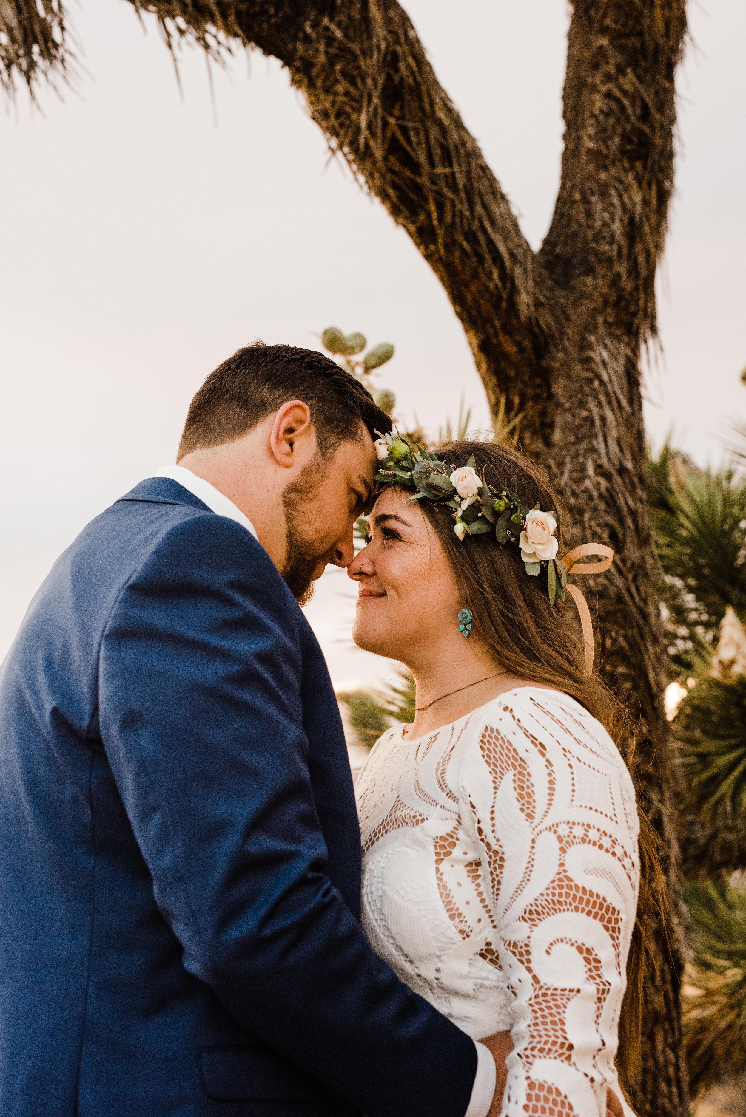 bride and groom beneath Joshua Tree in Yucca Valley