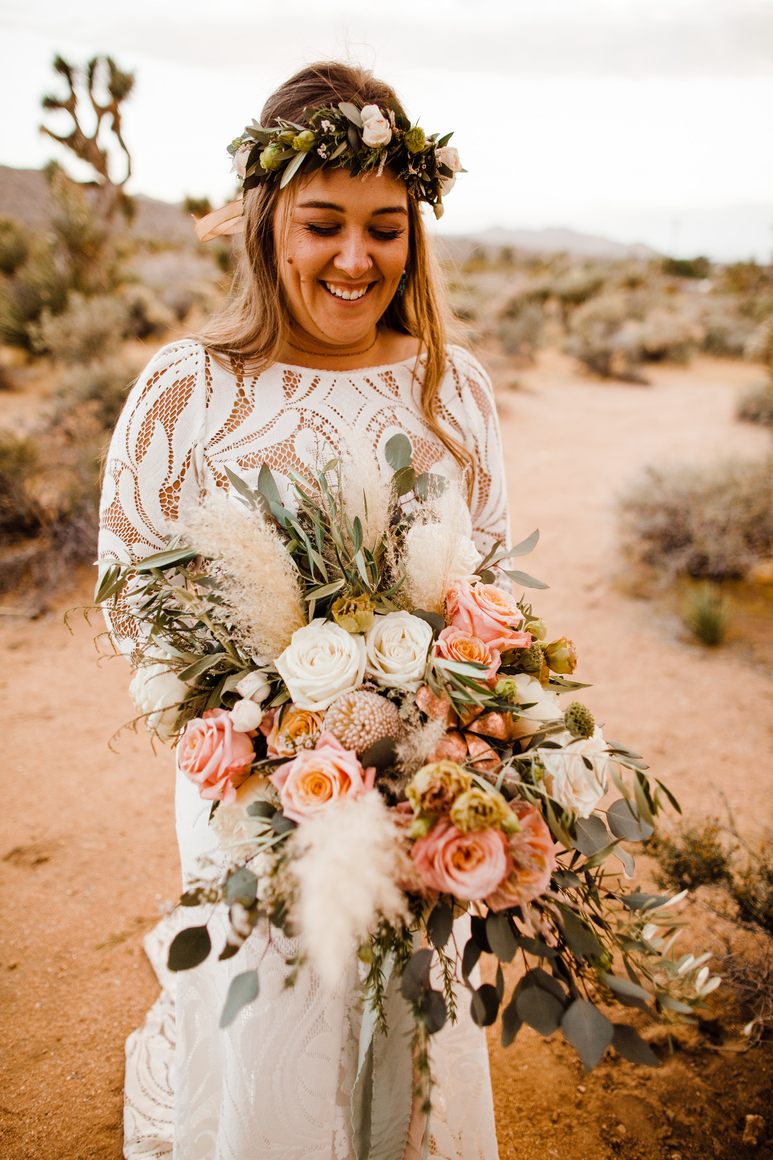 bride holding bouquet by Pinyon Pine floral design after tumbleweed sanctuary wedding