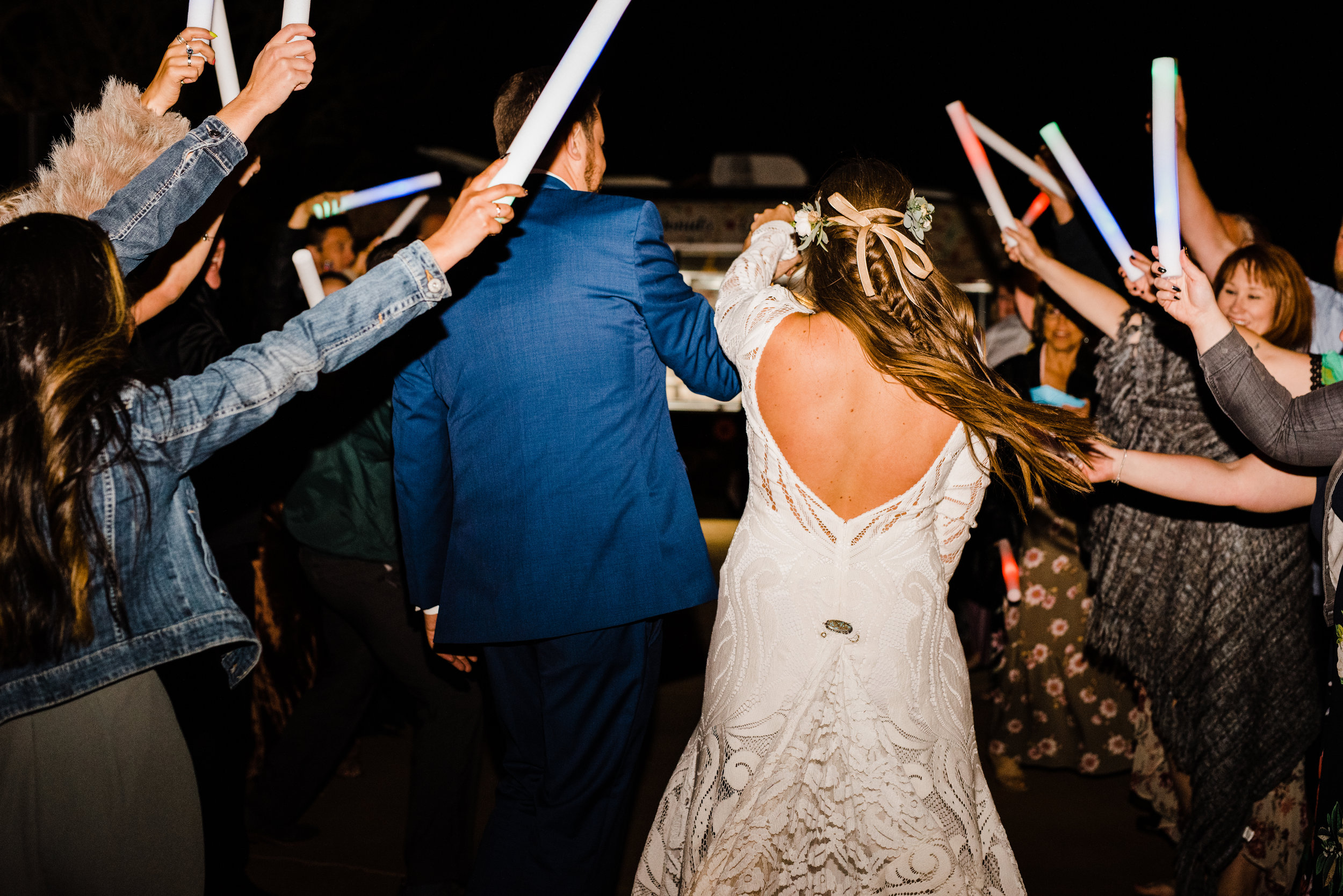 grand finale wedding exit with glow sticks at tumbleweed sanctuary